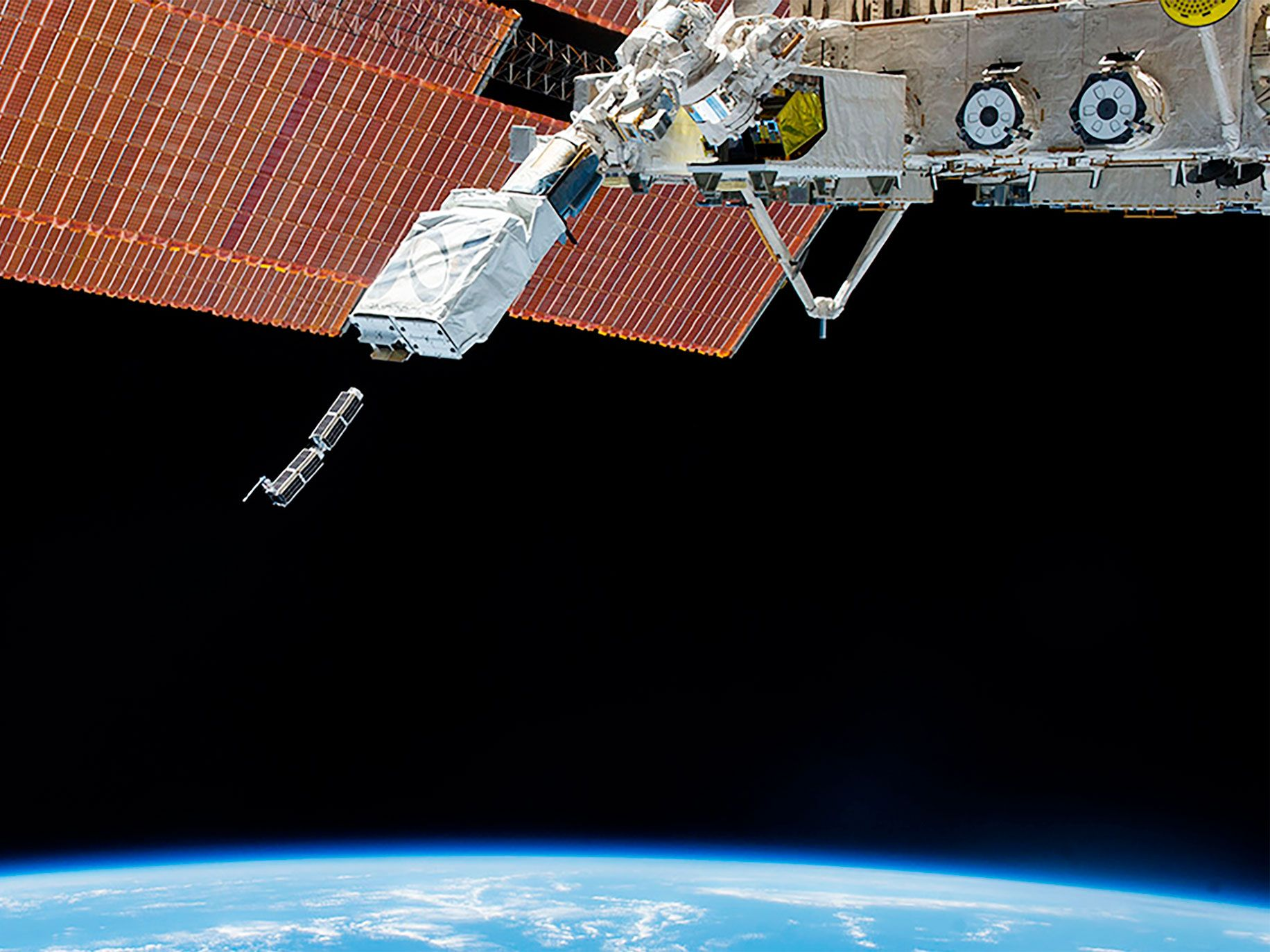 A pair of Planet's Dove satellites releasing from the International Space Station. The company began using the ISS for deployment in January 2014.