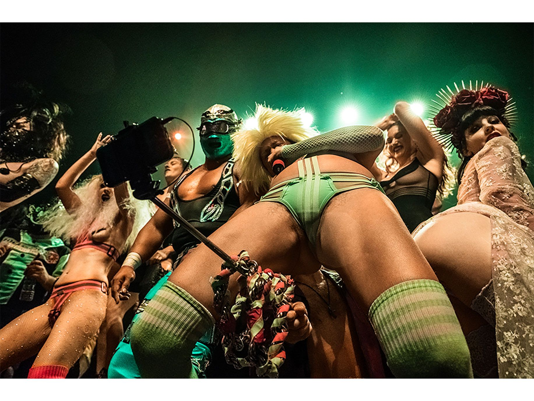 Peaches performs as Heino's arm sneaks through her legs for a selfie shot.
