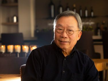 Stanley Cheng poses in his 10,000-bottle tasting room.