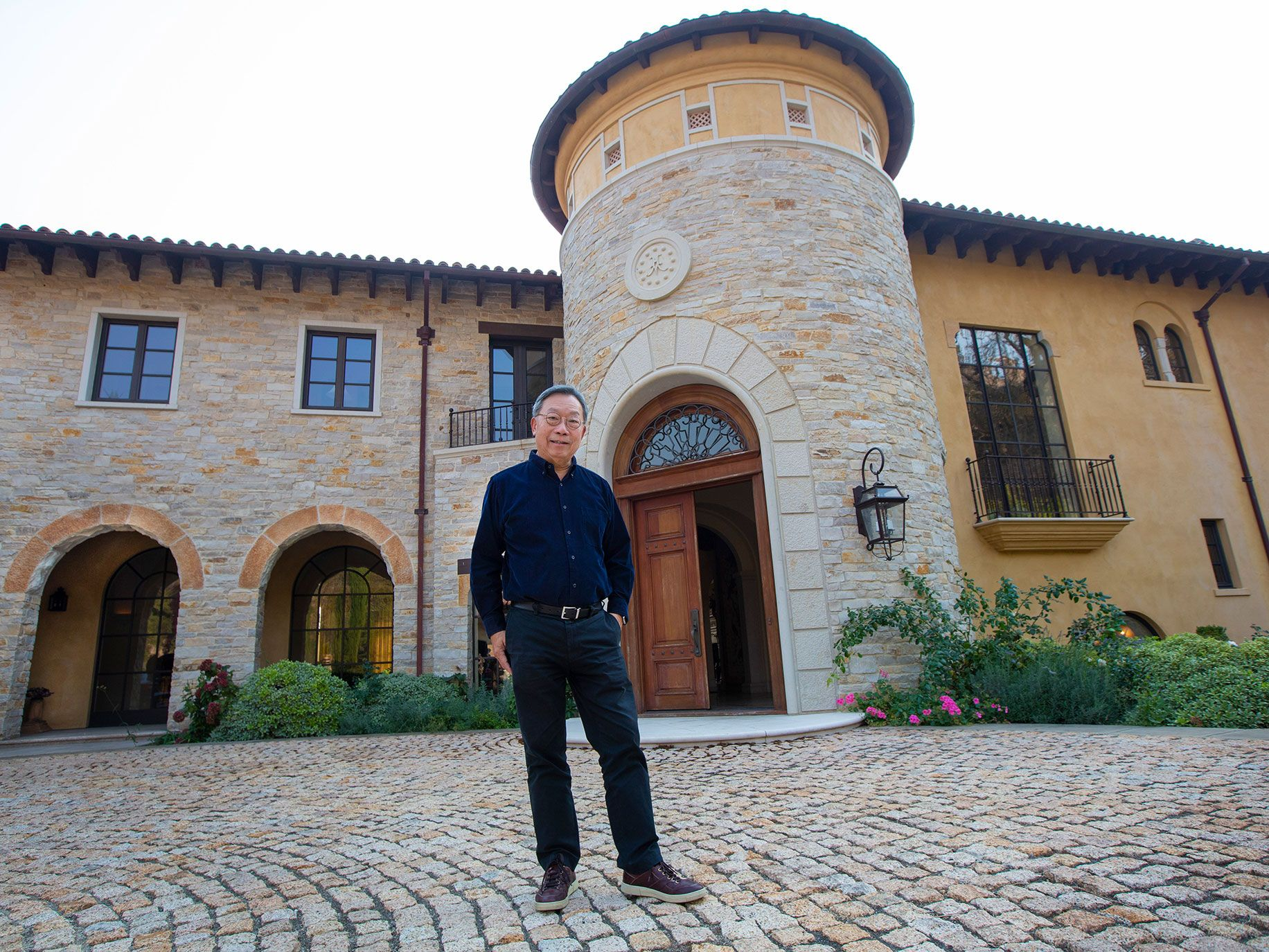 Businessman and vintner Stanley Cheng stands at the entry was to his Napa Valley home. The Chinese-born businessman built an empire on nonstick cookware.