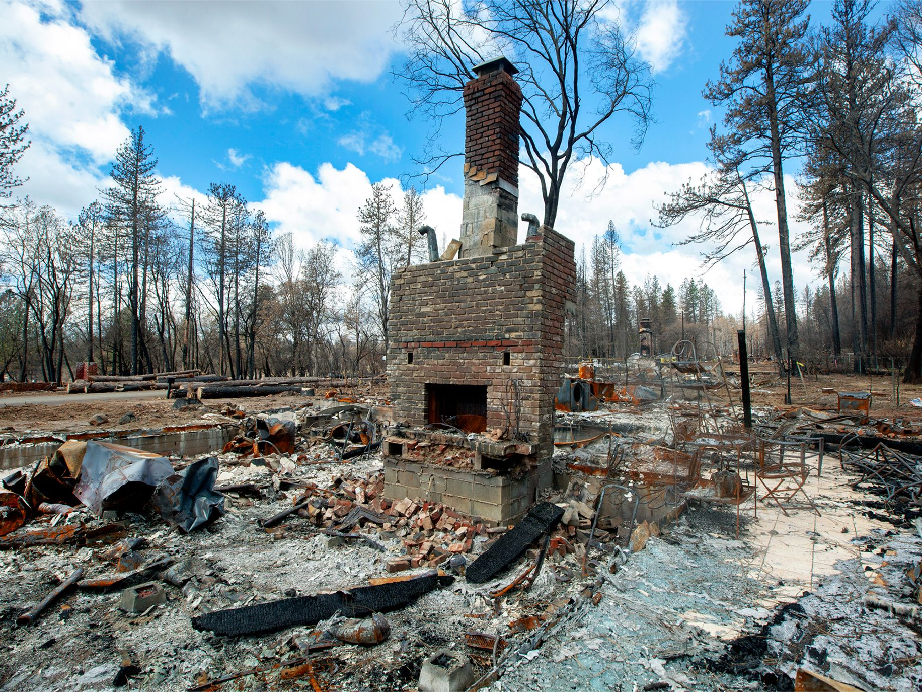 A chimney is all that remains of a home in Paradise.