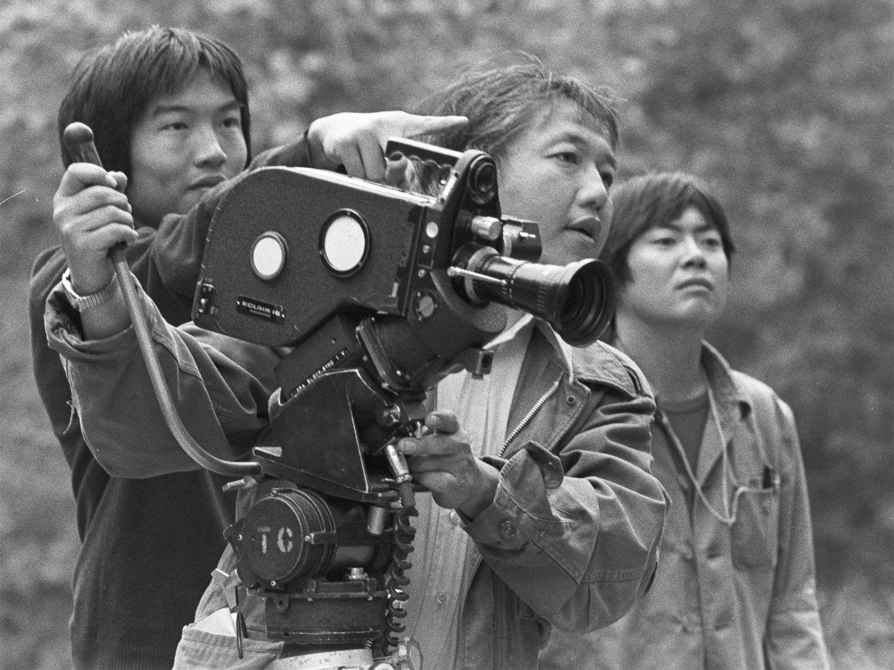 Visual Communications filmmakers Eddie Wong, Bob Nakamura, and Alan Kondo line up a shot, Los Angeles, circa 1972.