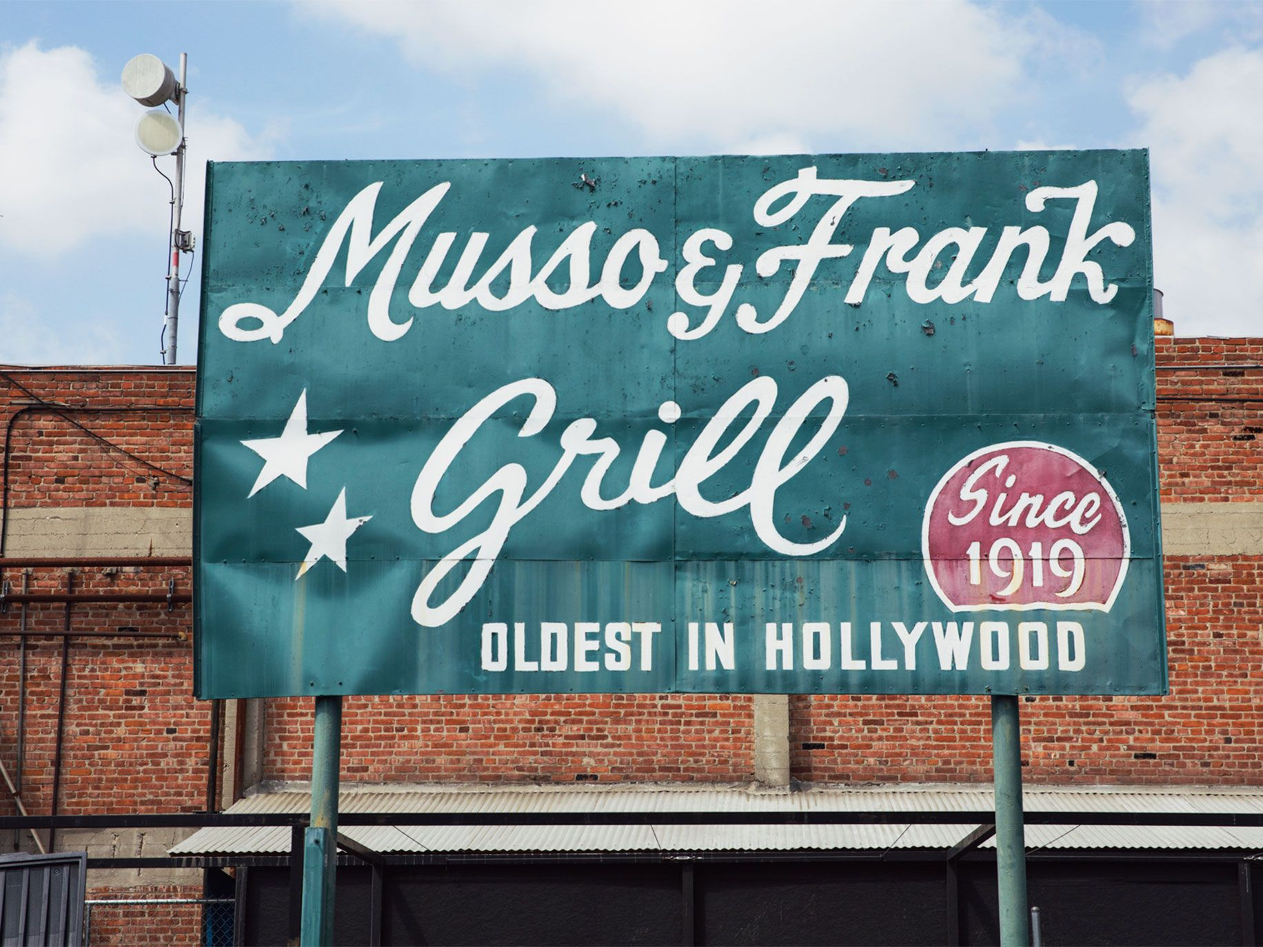 A sign in the rear parking lot hints at the colorful history inside the 100-year-old restaurant.