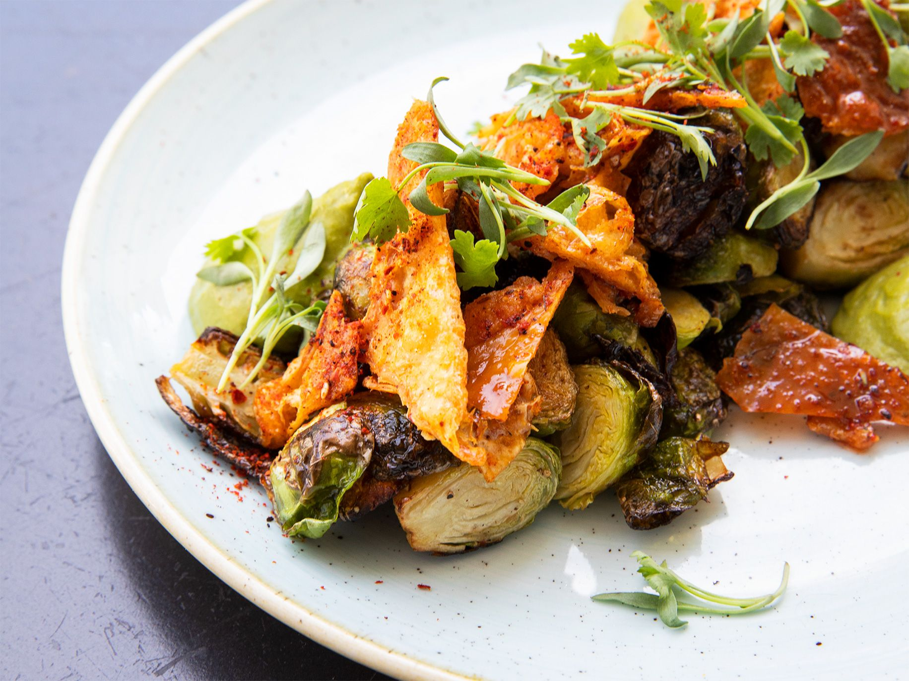 A dish of brussels sprouts includes chicken skin, revealing chef Peter McNee's inventive combinations.