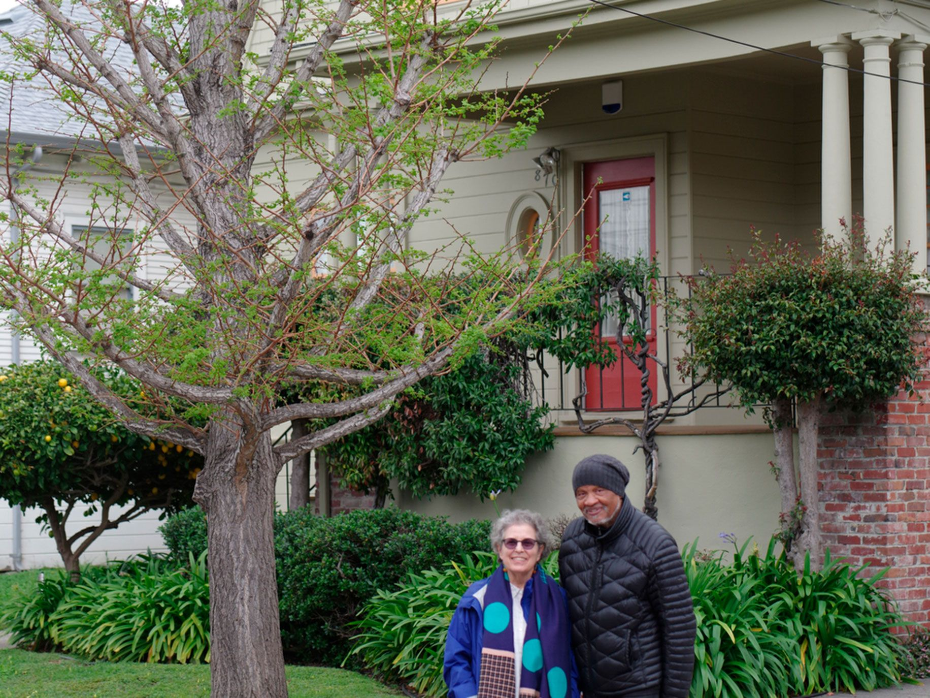 Ishmael Reed, left, and Carla Blank pose for a photograph in front of their North Oakland home in 2019.