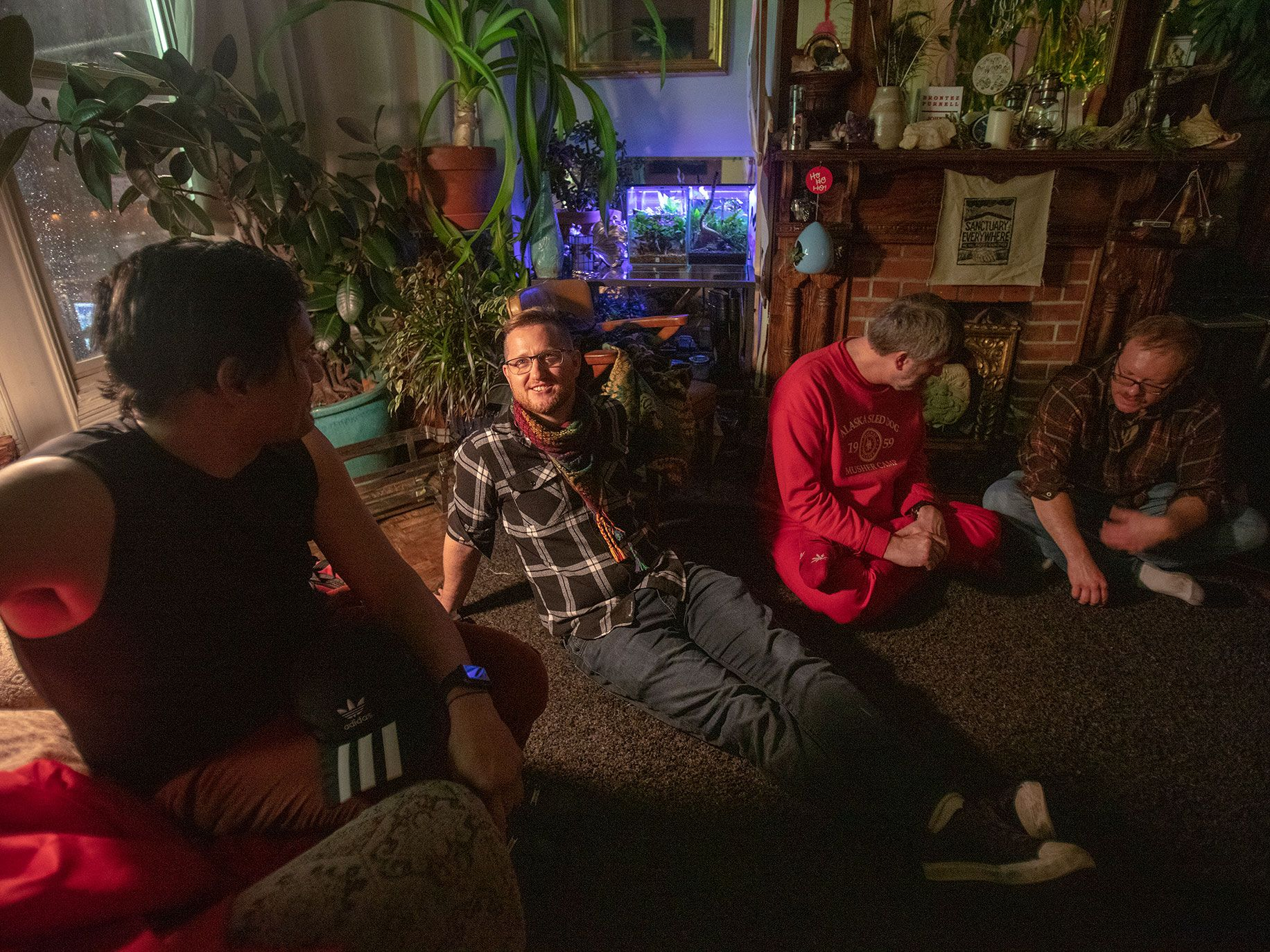 Radical Faeries activists Jesse Oliver Sanford (center) during a Radical Faeries potluck dinner held at his communal apartment in San Francisco's Castro District. The neighborhood, once a haven for the LGBTQ+ community, has become popular with heterosexual families.
