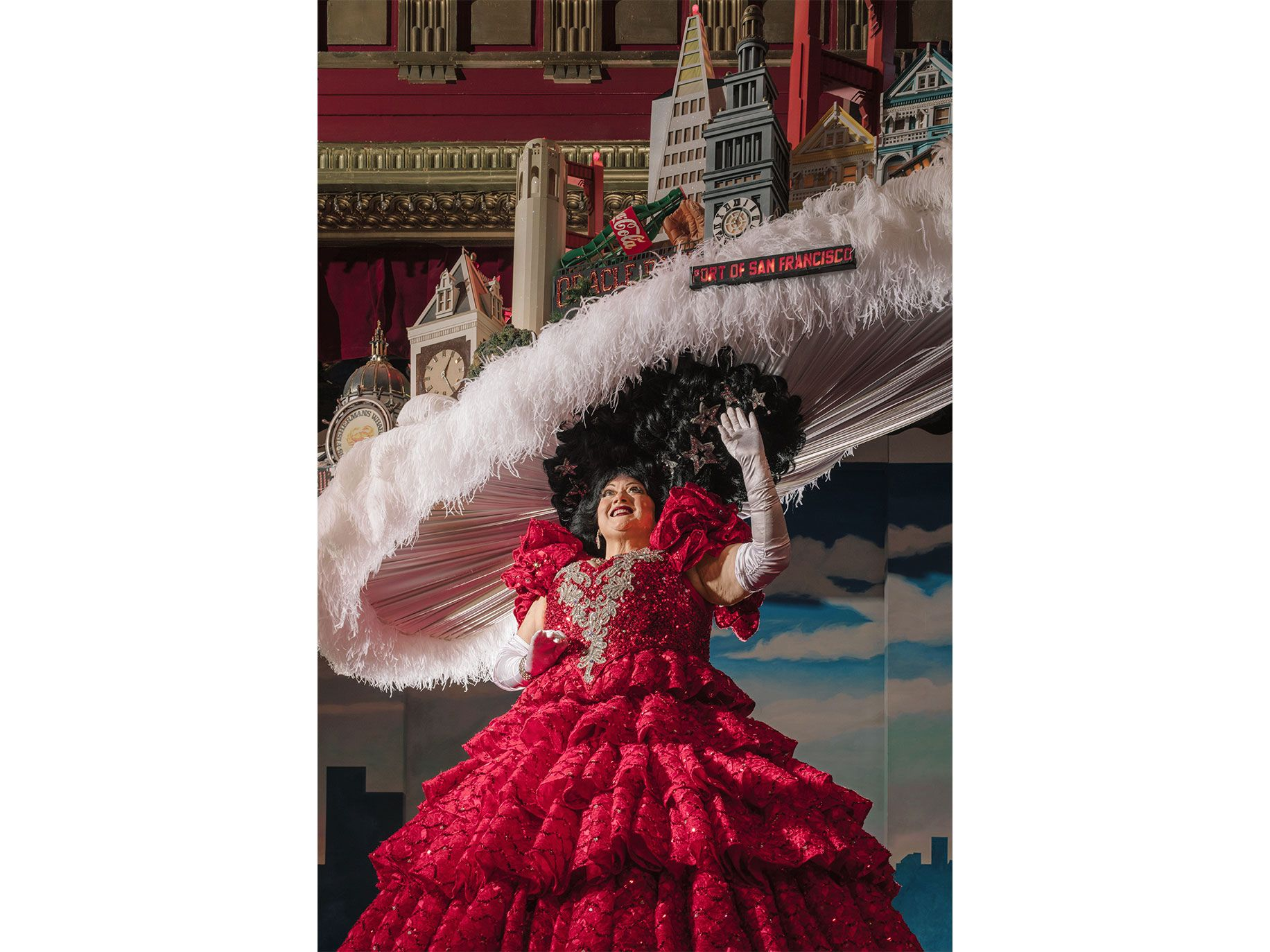 Tammy Nelson performs the finale of Beach Blanket Babylon wearing a San Francisco skyline hat, which includes a cable car and the Transamerica Pyramid.