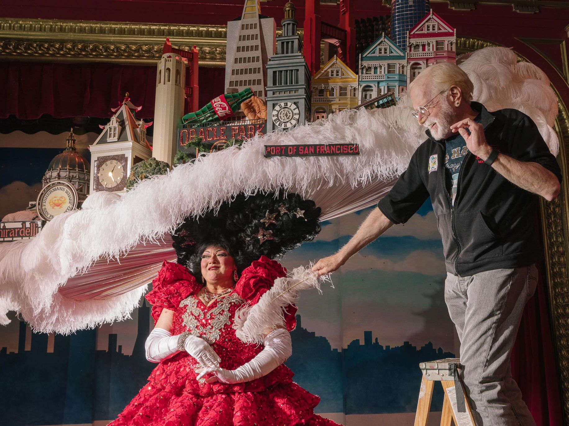 Tammy Nelson performs the finale of Beach Blanket Babylon wearing a San Francisco skyline hat and Alan Greenspan, the show's longtime hat designer and maker.