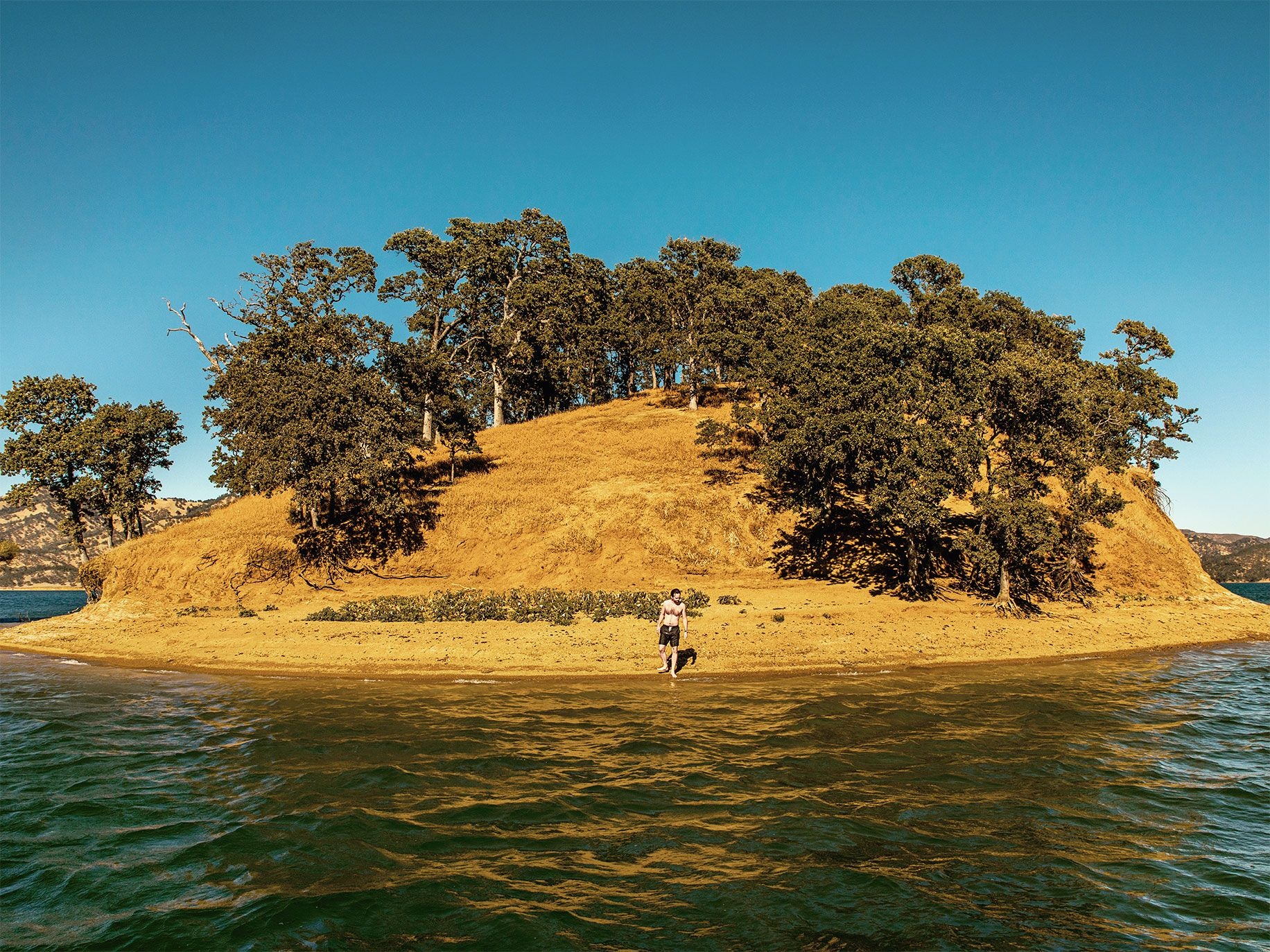 An island like this was once a hilltop that looked over the Berryessa Valley below. Today the lake is a popular recreation spot.