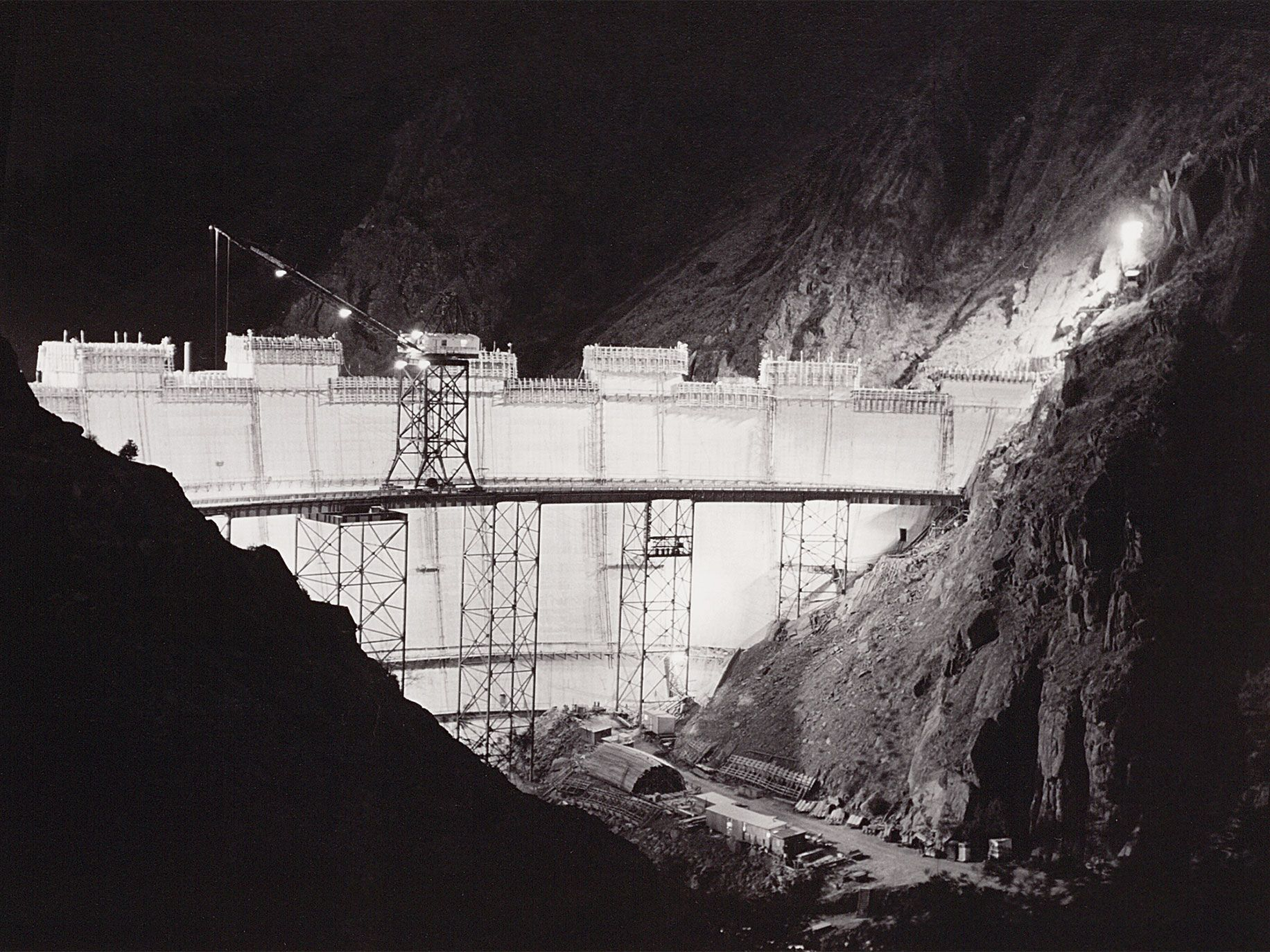 Monticello Dam by Dorothea Lange showcases the unfinished Monticello Dam at night, when it seemed to glow with malevolent light.