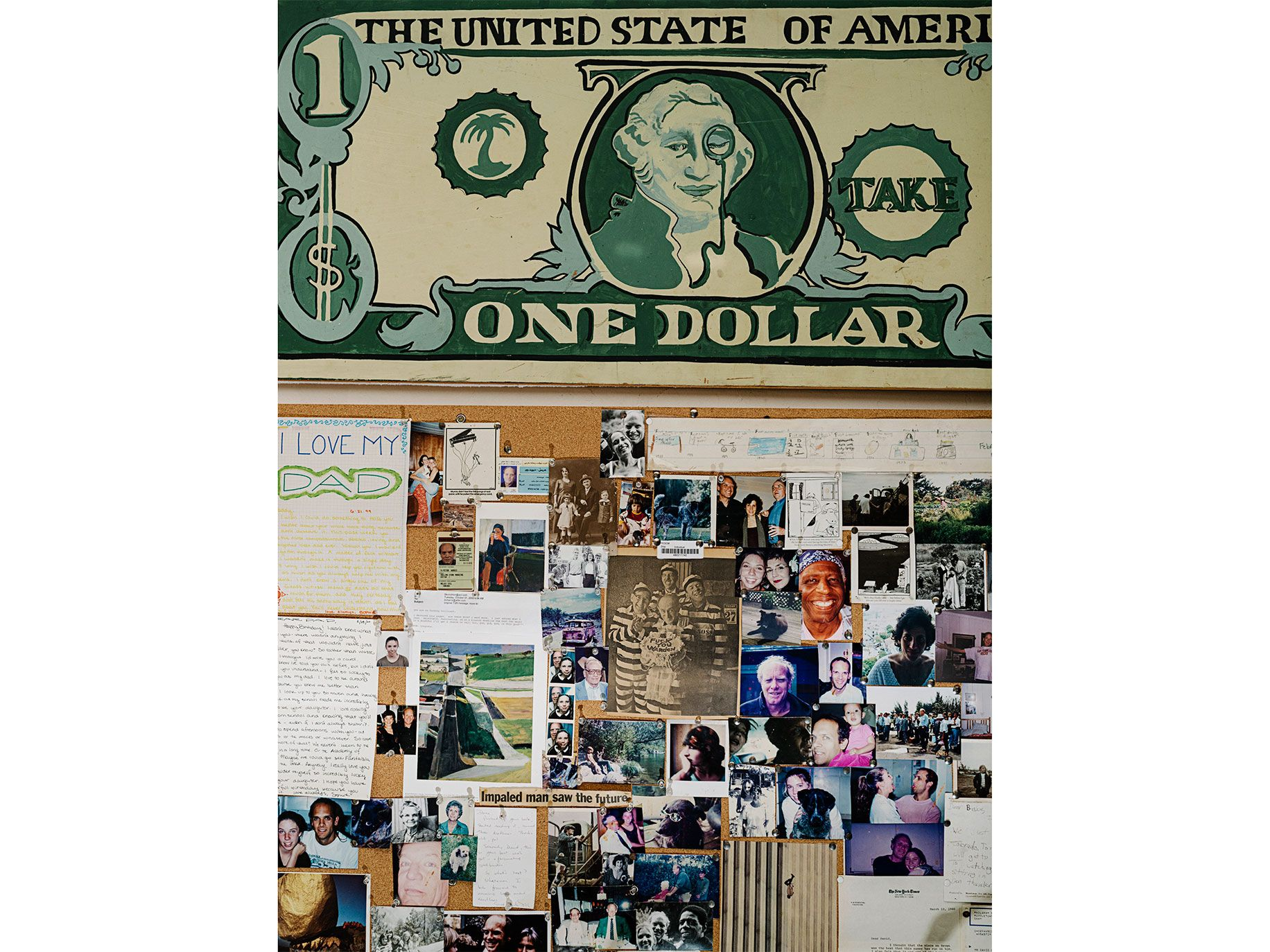 Paintings, letters, photos, and clippings line the walls of Harris's home office.