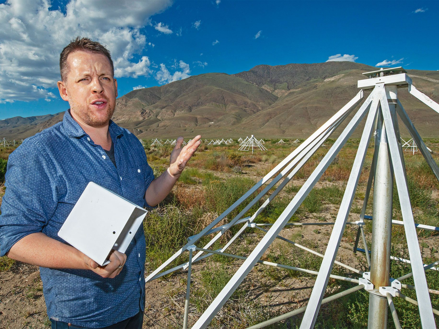 Caltech professor Gregg Hallinan examines the receiver from one of the antennae he designed for the Long Wavelength Array. His team can build an antenna in as little as 15 minutes.