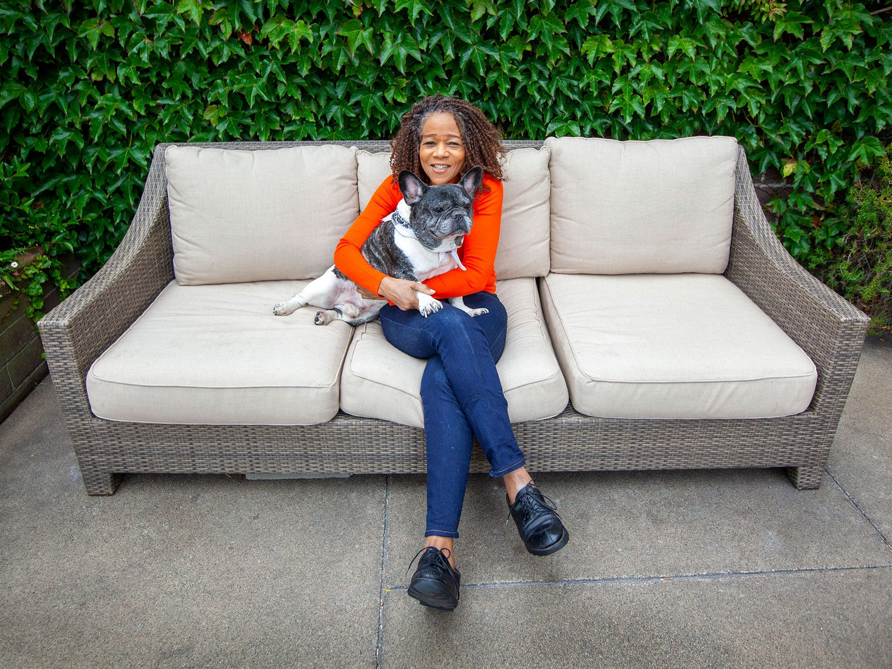 Jazz singer Paula West snuggles with Satchmo, her beloved 11-year-old French bulldog.