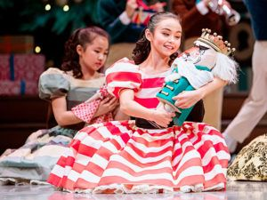 Elise Hueffed, as Clara, in a scene from George Balanchine's The Nutcracker. Pacific Northwest Ballet's production features sets and costumes designed by Ian Falconer and runs November 29–December 28, 2019.