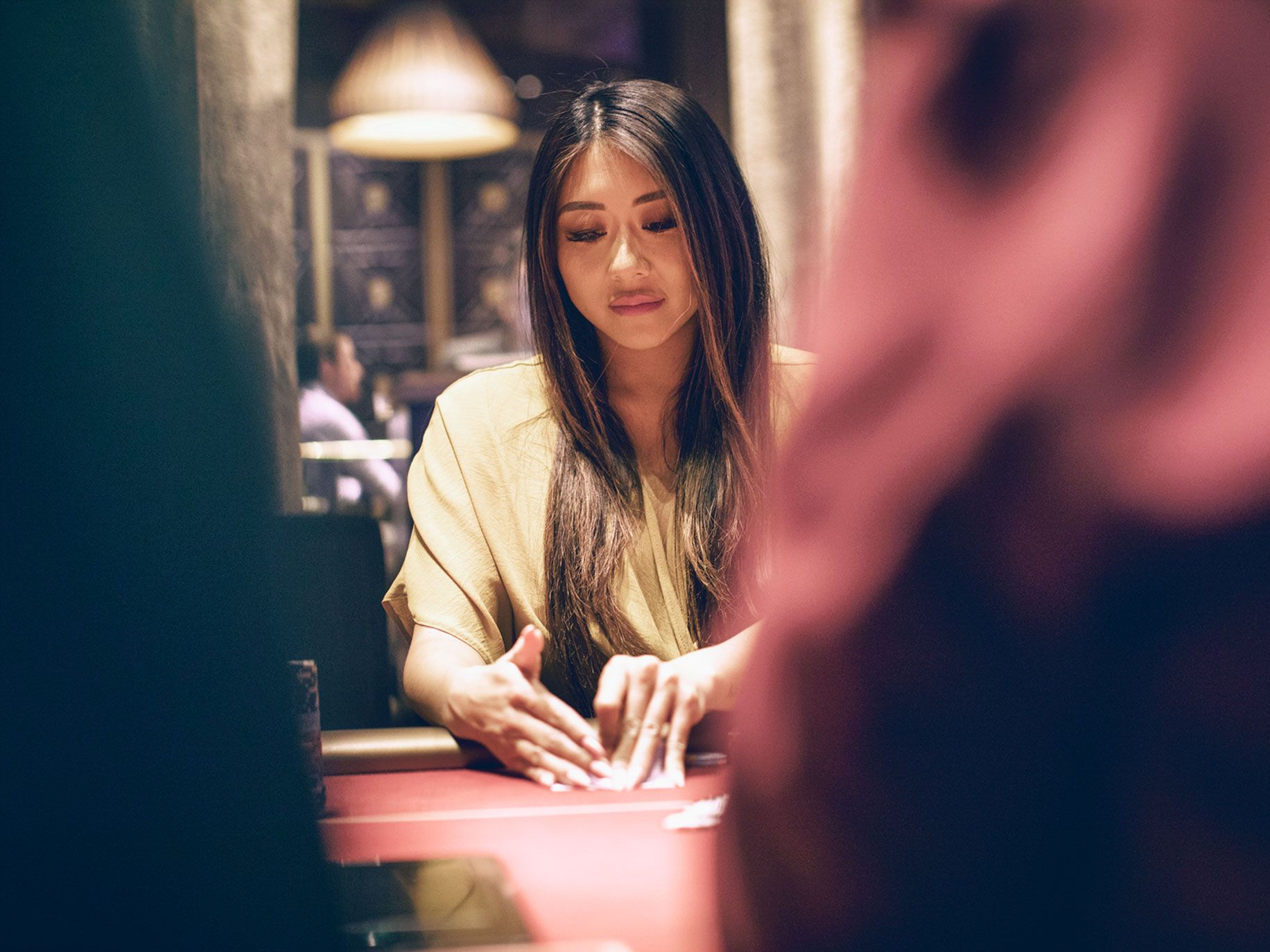 Maria Ho playing a hand during the six-week-long World Series of Poker in Las Vegas this year. The L.A. resident competed in 30 of the series' nearly 90 events and made frequent appearances as a poker analyst on ESPN during the tournament.