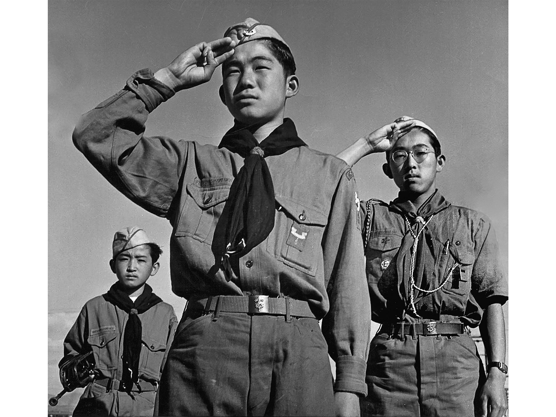 "Boy Scouts Junzo Jake Ohara, Takeshi Motoyasu, and Eddie Tetsuji Kato (from left) honor the American flag during a ceremony at the Heart Mountain War Relocation Center, in Wyoming, in 1943. ""I never thought of myself as a Jap, you know,"" Kato told Paul Kitagaki Jr. ""I just thought of myself as an American citizen, because that's how I was raised."""