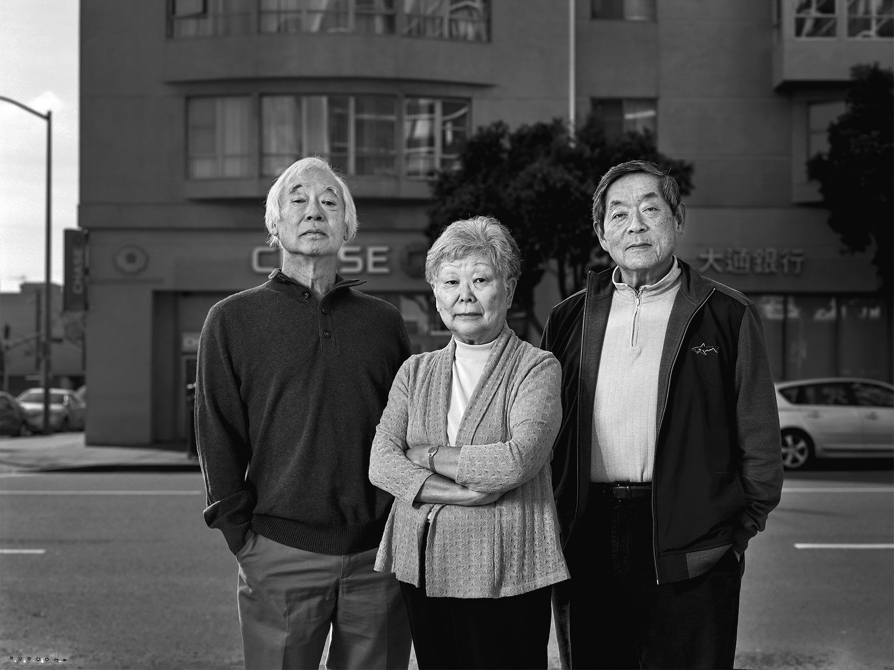 Gerry Naruo, 68, Karen Hashimoto, 73, and Ted Tanisawa, 71, all cousins on the Masuda side of the family, photographed in 2016 where their family's Oakland store was once located.