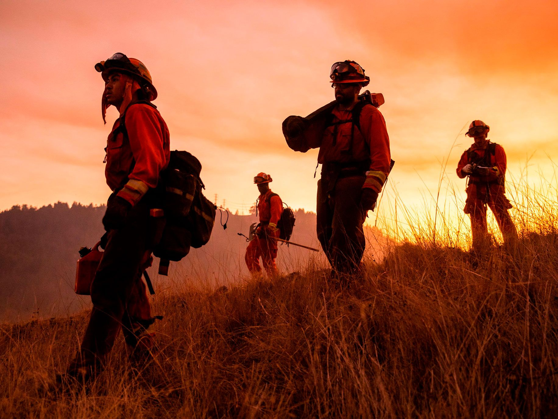 A crew of inmate firefighters make their way to firefighting operations to battle the Kincade Fire in Healdsburg, California on October 26, 2019. - US officials on October 26 ordered about 50,000 people to evacuate parts of the San Francisco Bay area in California as hot dry winds are forecast to fan raging wildfires.