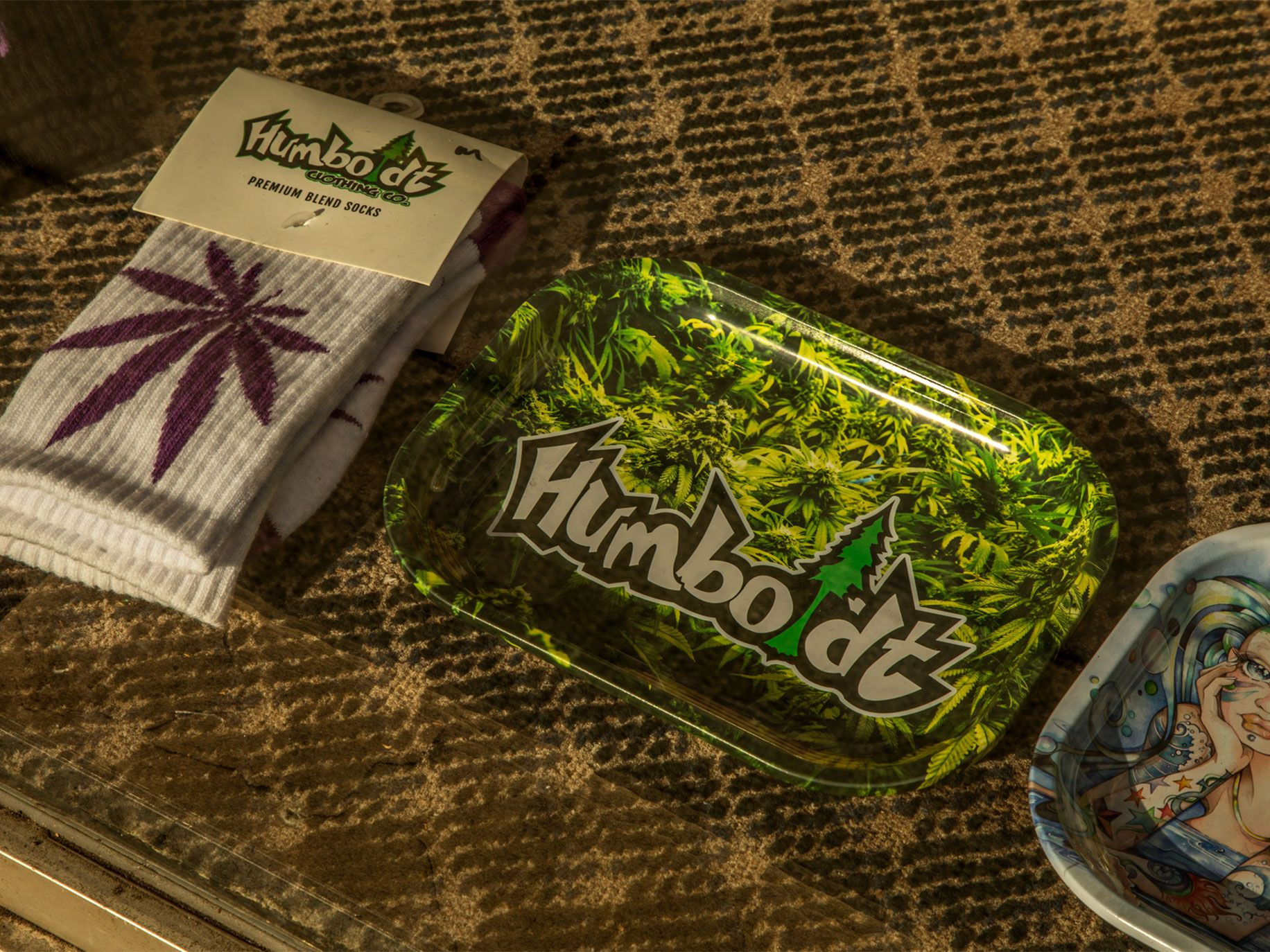 Cannabis-themed products reinforce the area's ties to the crop. Items for sale at Humboldt Outfitters, a store next to Arcata Plaza, include socks and trays.