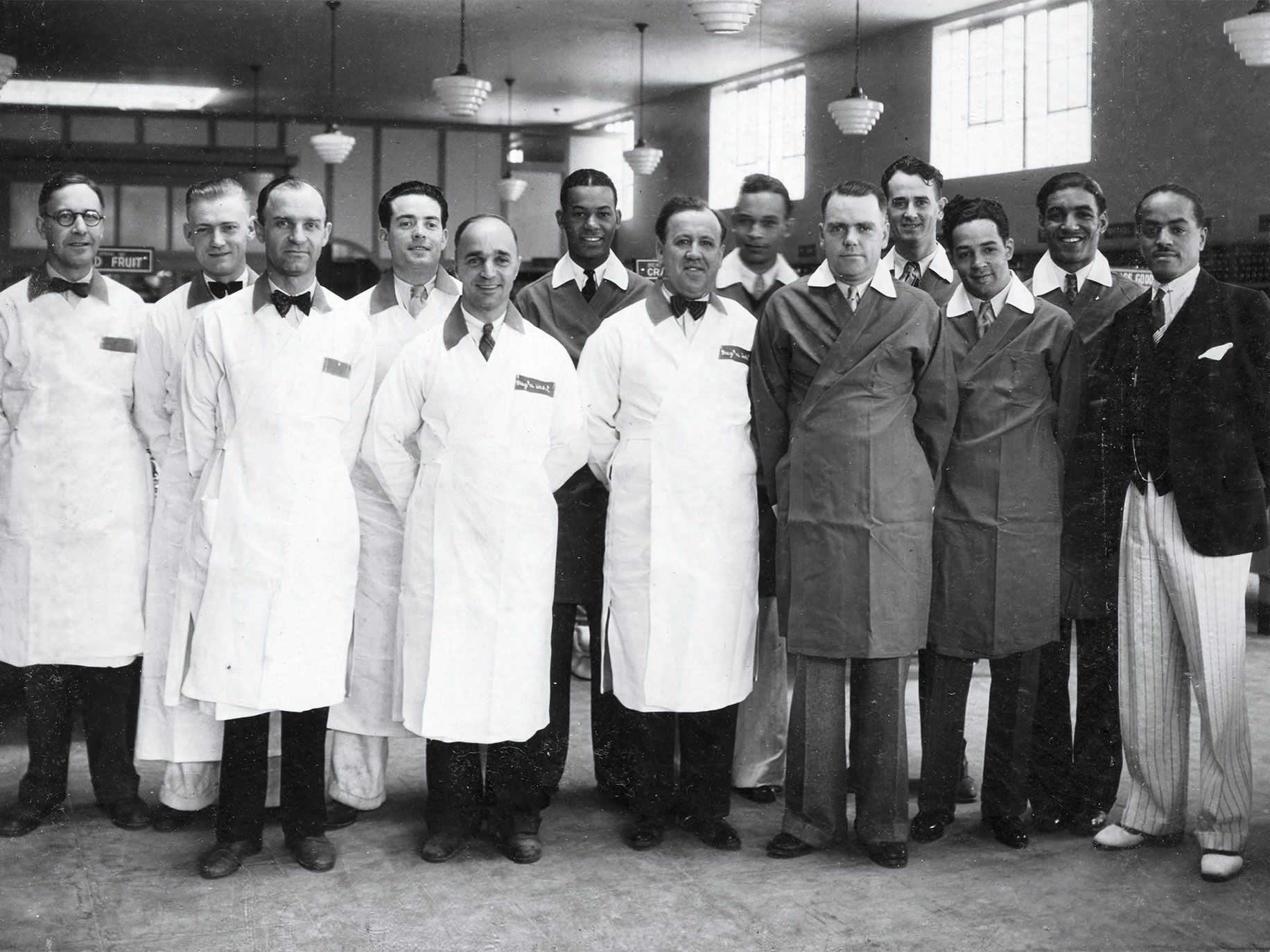 Covington (far right) with clerks at Pay 'n Takit, a Los Angeles store whose workforce he helped integrate, circa 1933.