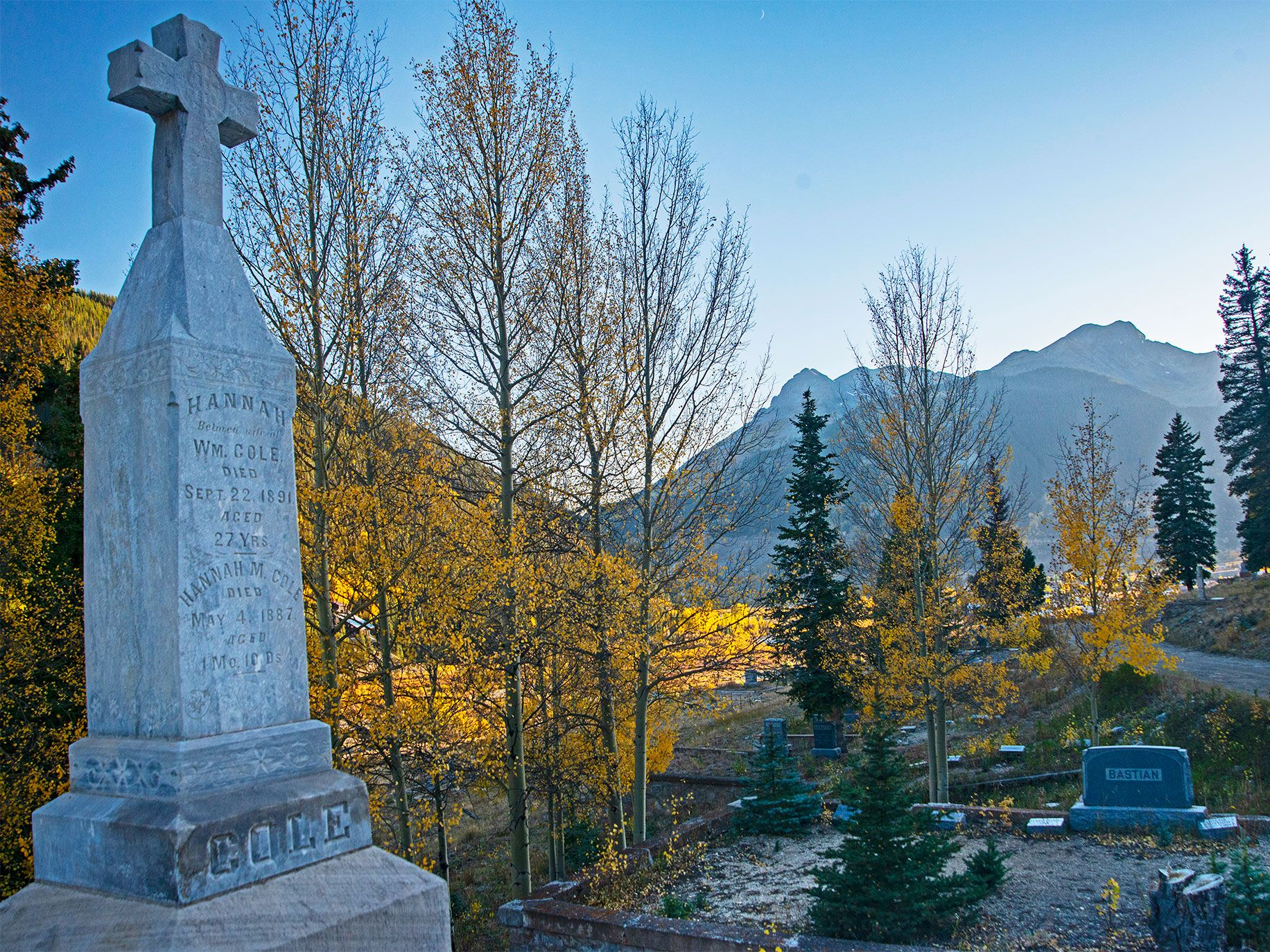 Gravestones at the Hillside Cemetery in Silverton, Colorado, bear witness to mining accidents and illnesses like pneumonia, typhoid fever, diphtheria, and the flu epidemic of 1918 that killed many of its citizens.