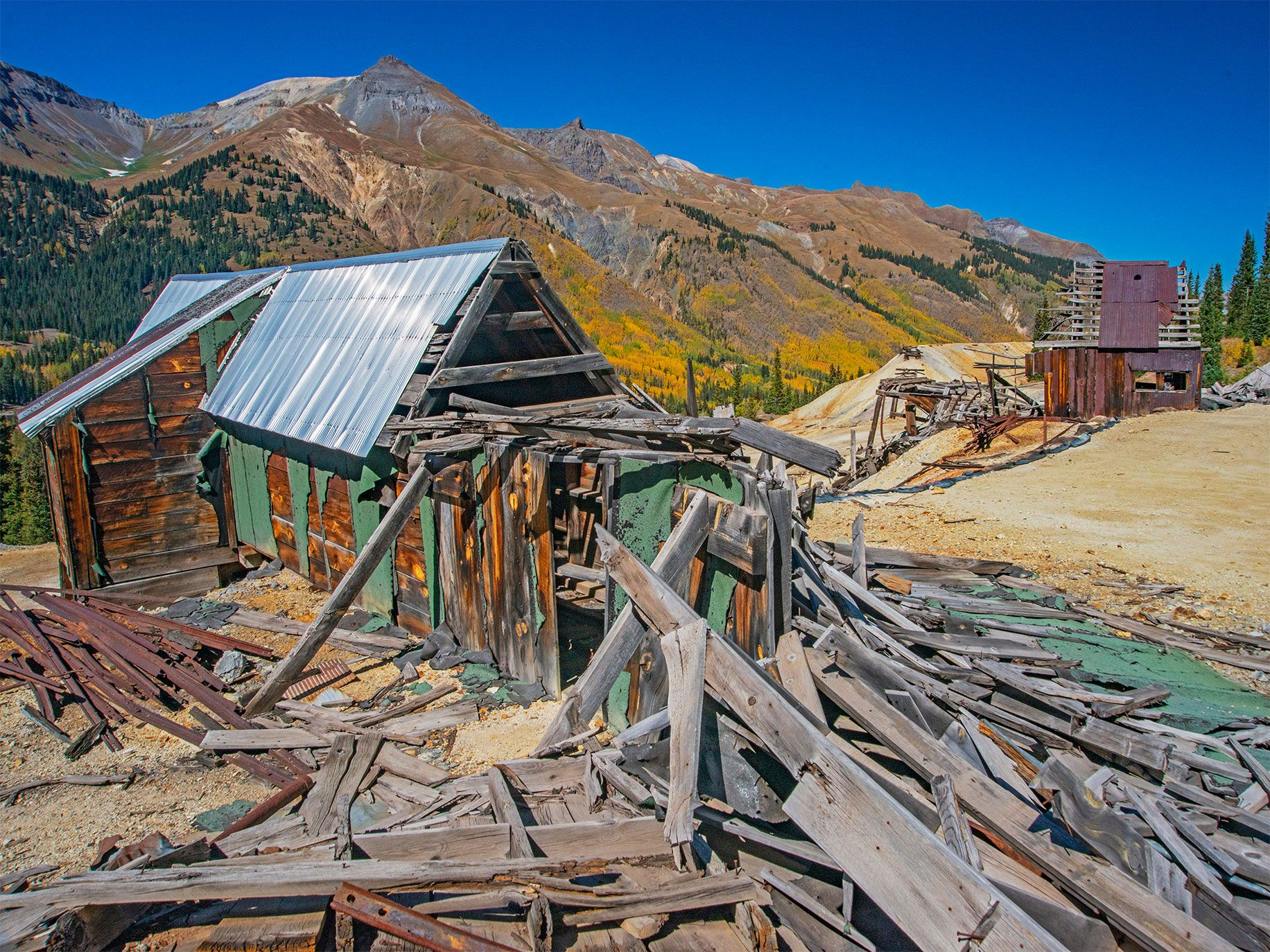Old mine buildings teeter on mountainsides in the Red Mountain Mining District of southwestern Colorado. Known as the Million Dollar Highway, nearly 40 area mines produced silver during a 10-year boom, which began in 1882 and ended with the Panic of 1893.