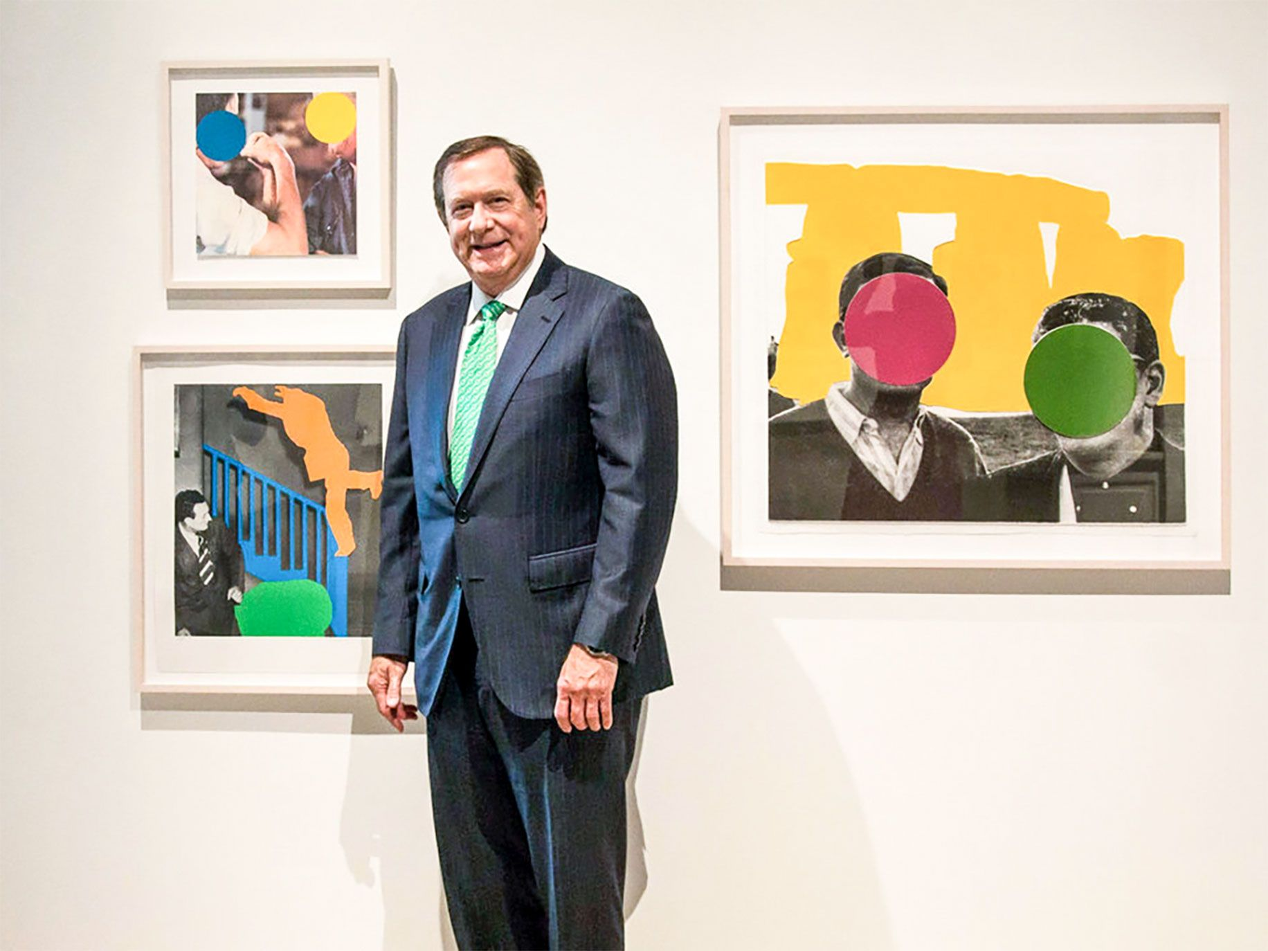 Real estate magnate Jordan D. Schnitzer poses with three works by John Baldessari. Schnitzer's private print collection—one of the largest in the world—contains more than 13,000 works by Andy Warhol, Roy Lichtenstein, Barbara Kruger, and others.