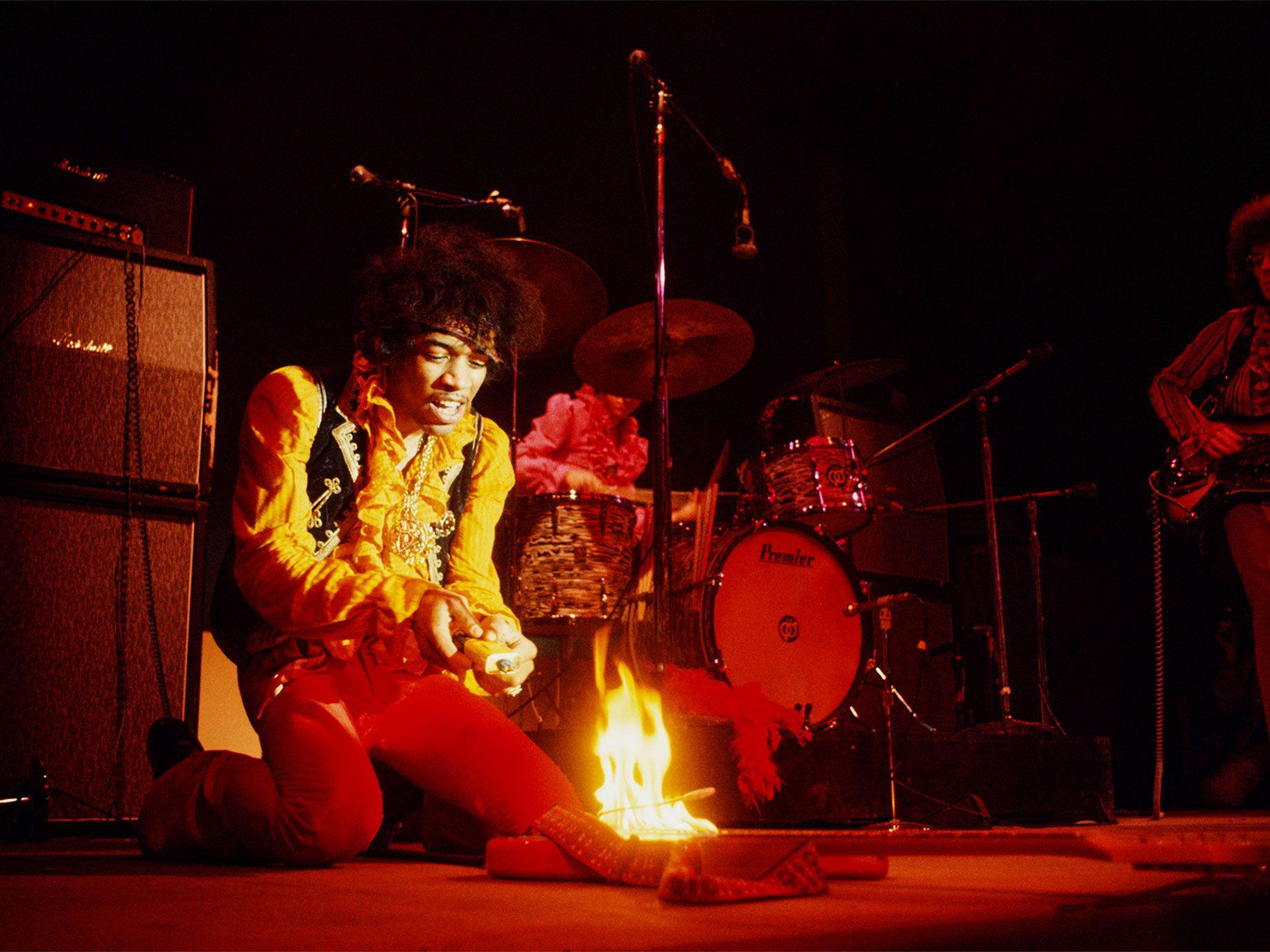 Jimi Hendrix lighting his guitar on fire, Monterey Pop Festival, Monterey, California, 1967.