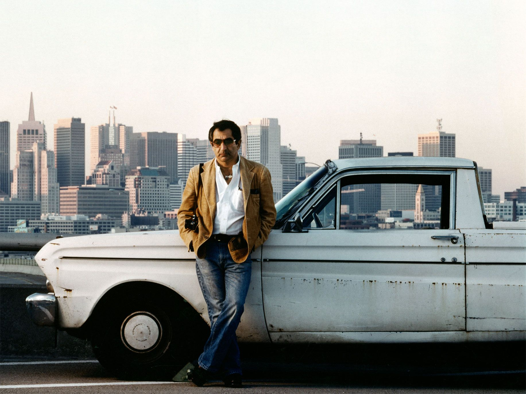 Jim Marshall with his truck on a Highway 101 off-ramp, San Francisco, circa 1985.