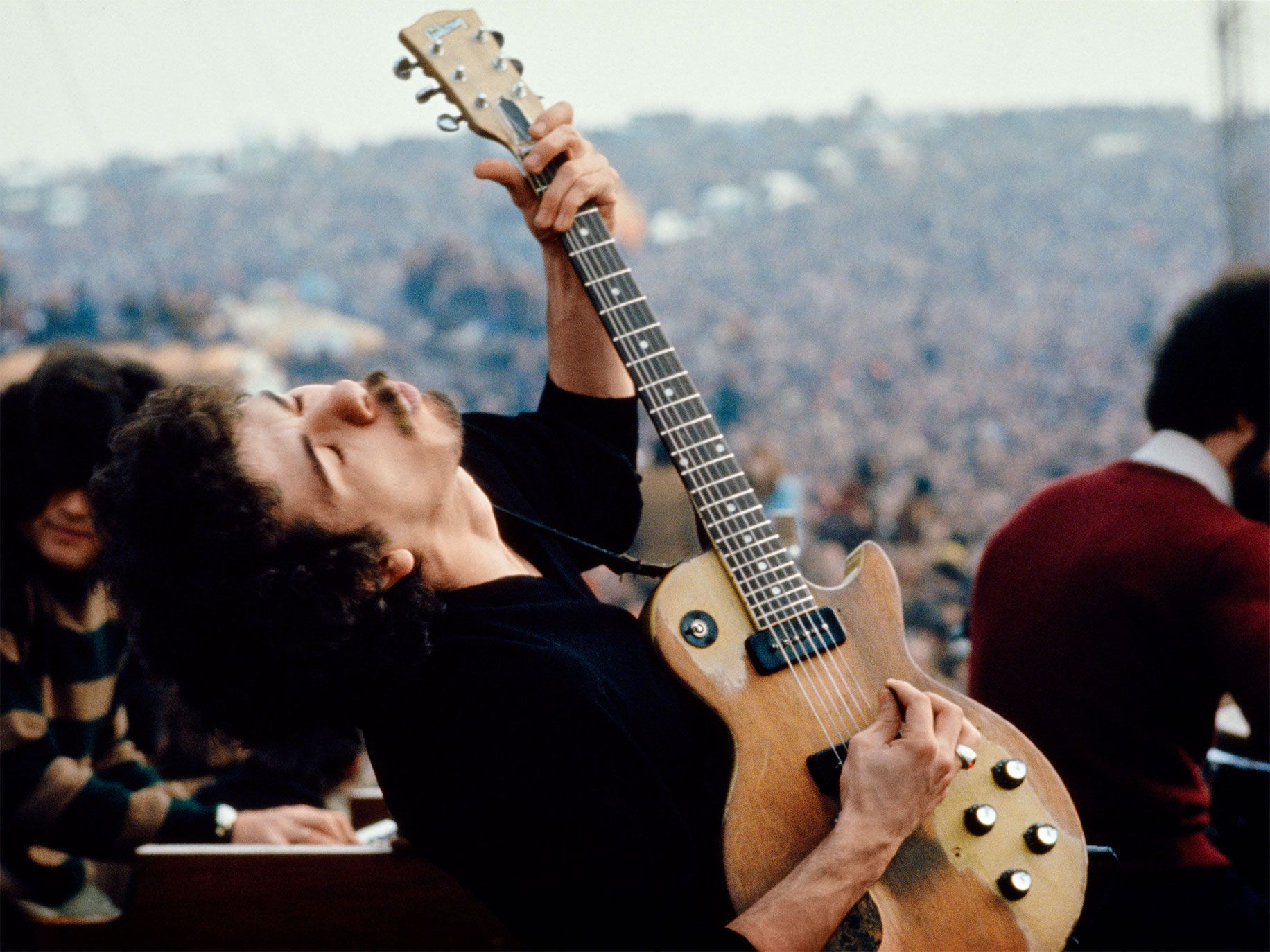 Carlos Santana performing at the Altamont Free Festival, Altamont Speedway, California, 1969.