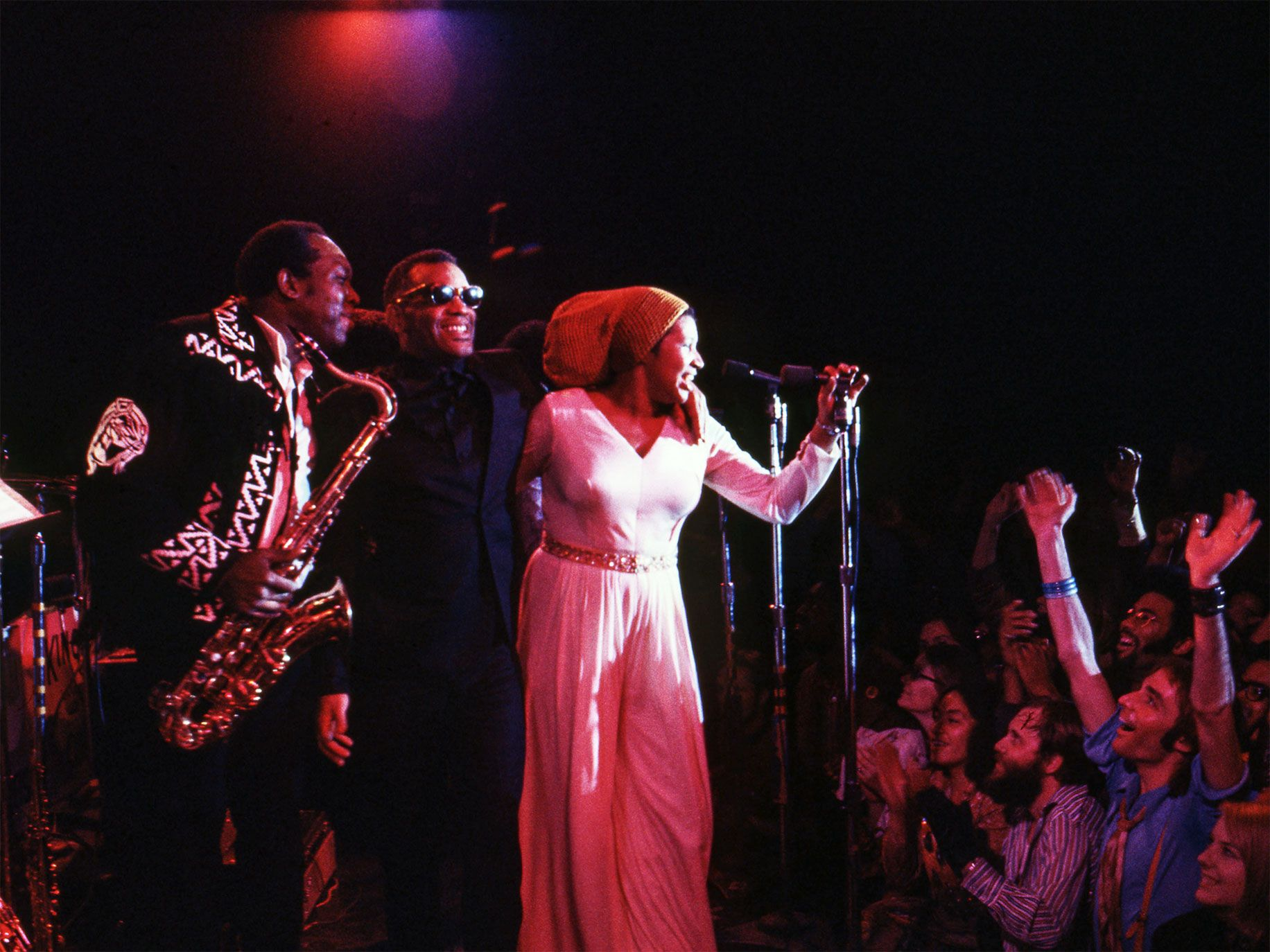 King Curtis, Ray Charles (center), and Aretha Franklin at the Fillmore West, San Francisco, 1971.