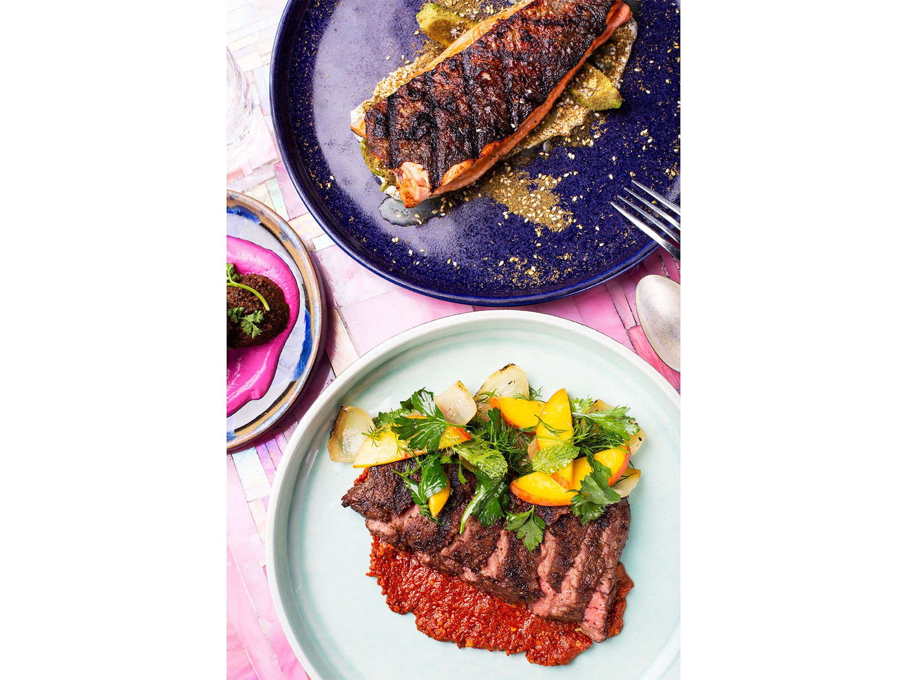 Bavette steak with muhamarra and grilled trout with Middle Eastern spices.