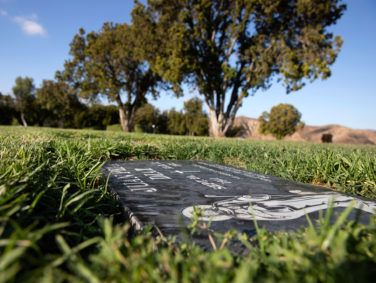 A black headstone marks the grave of Juan Peña Diaz, an undocumented worker from Mexico who was killed by Anaheim police in 1953.