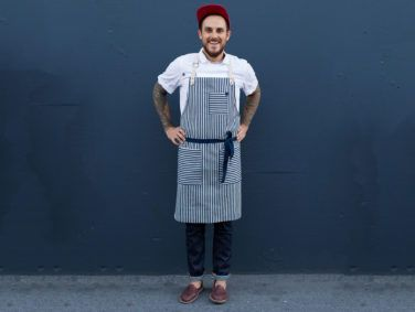 The Sailor Classic Apron ($109) has brass hardware and a leather neck strap, and is made from indigo striped denim.