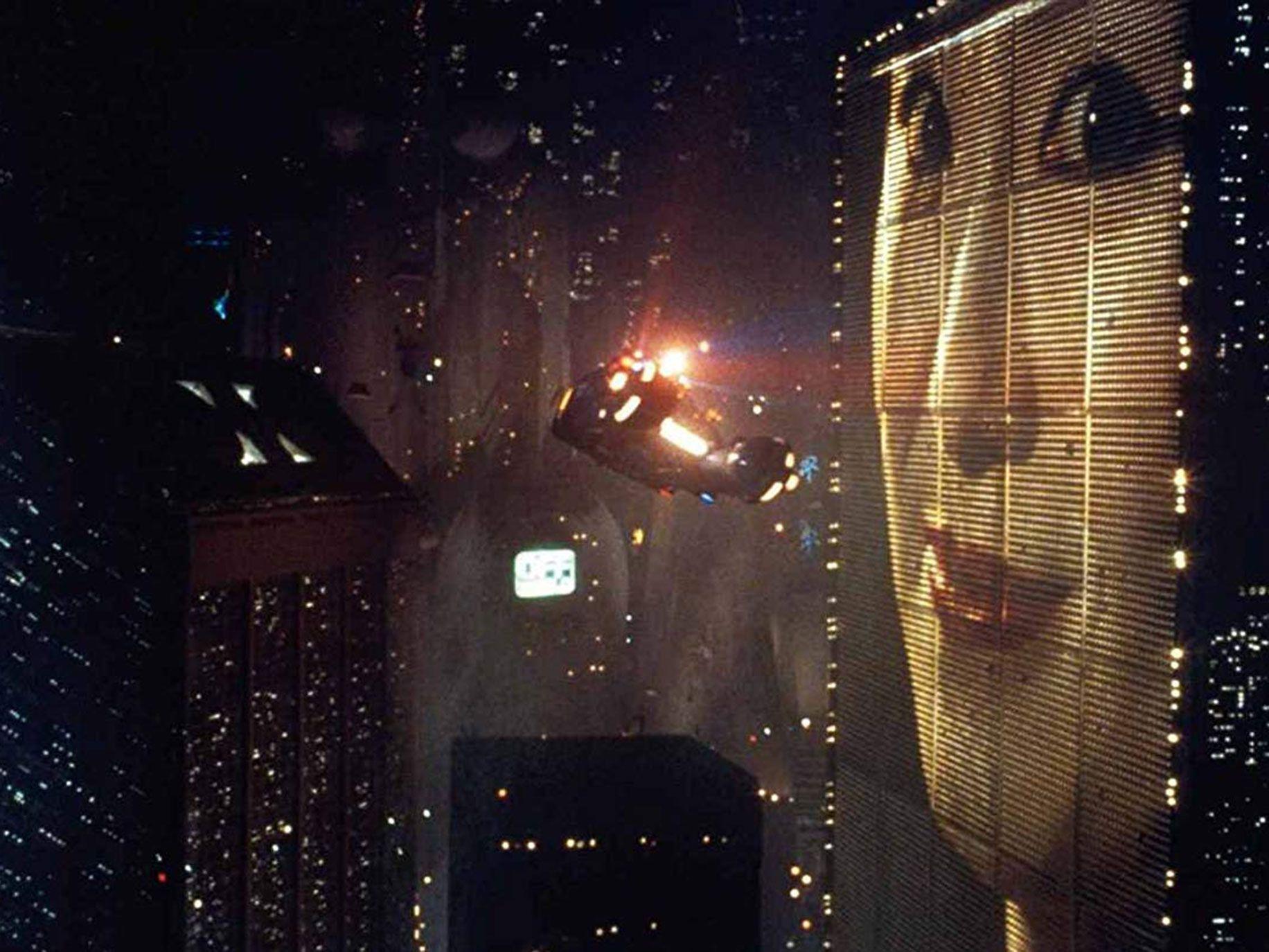 Scene from Blade Runner showing giant billboard.