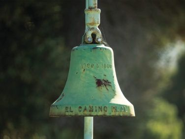 California is home to some 500 bells like this one across from Carmel Mission. The bells started as a tourism campaign—to evoke a sentimental view of the state's Spanish rancho past—but have evolved for many into a symbol of the era's oppression.
