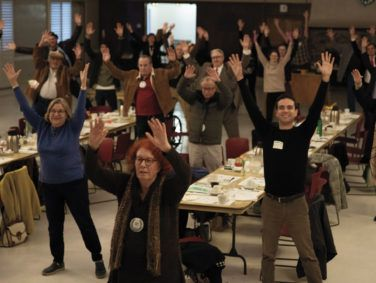 At their weekly Wednesday meeting, Los Angeles Breakfast Club members engage in a morning stretch they call Wiggle Waggle.