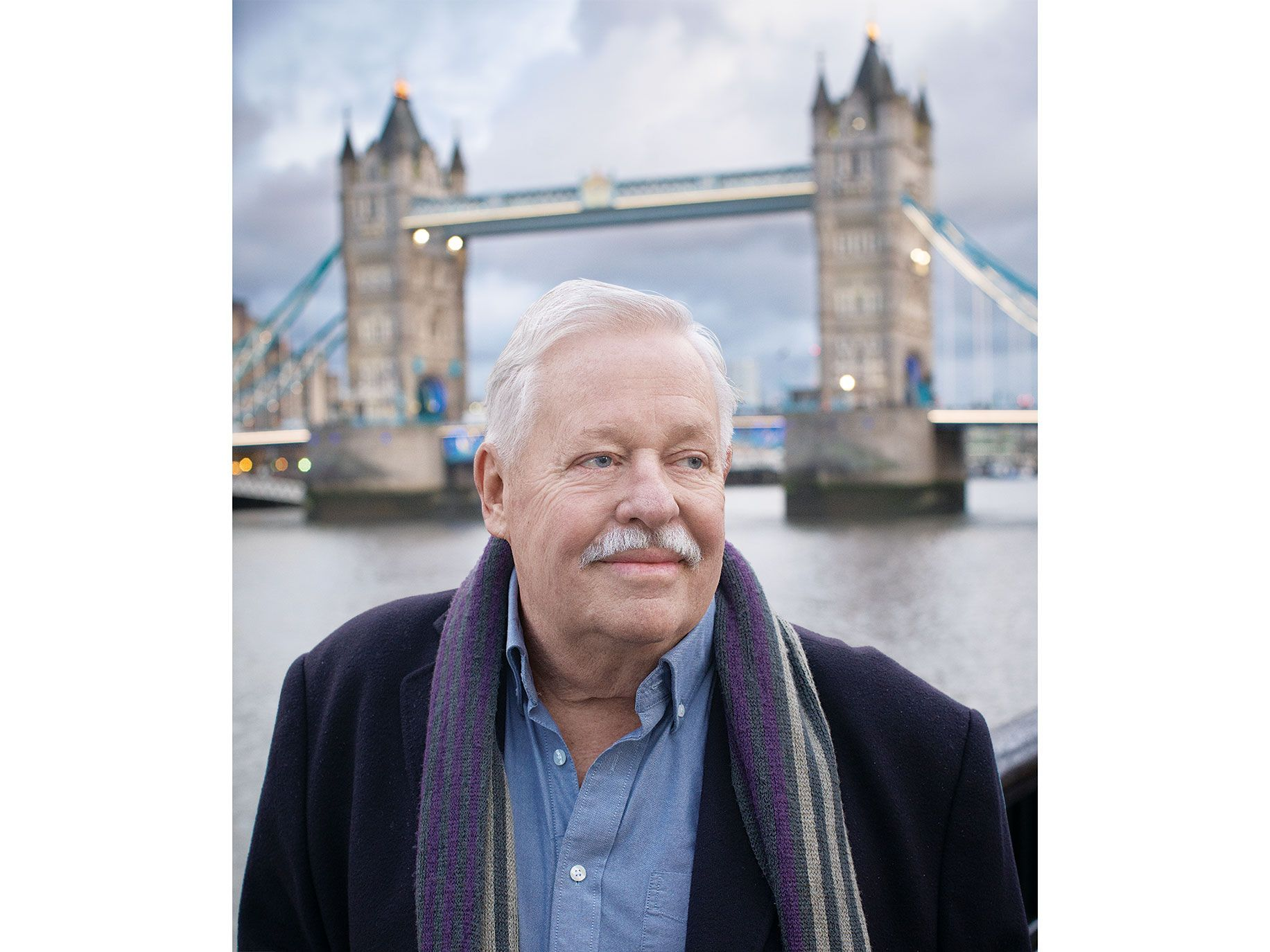 Armistead Maupin near London Bridge. The author is happily settling into life in England after leaving San Francisco.