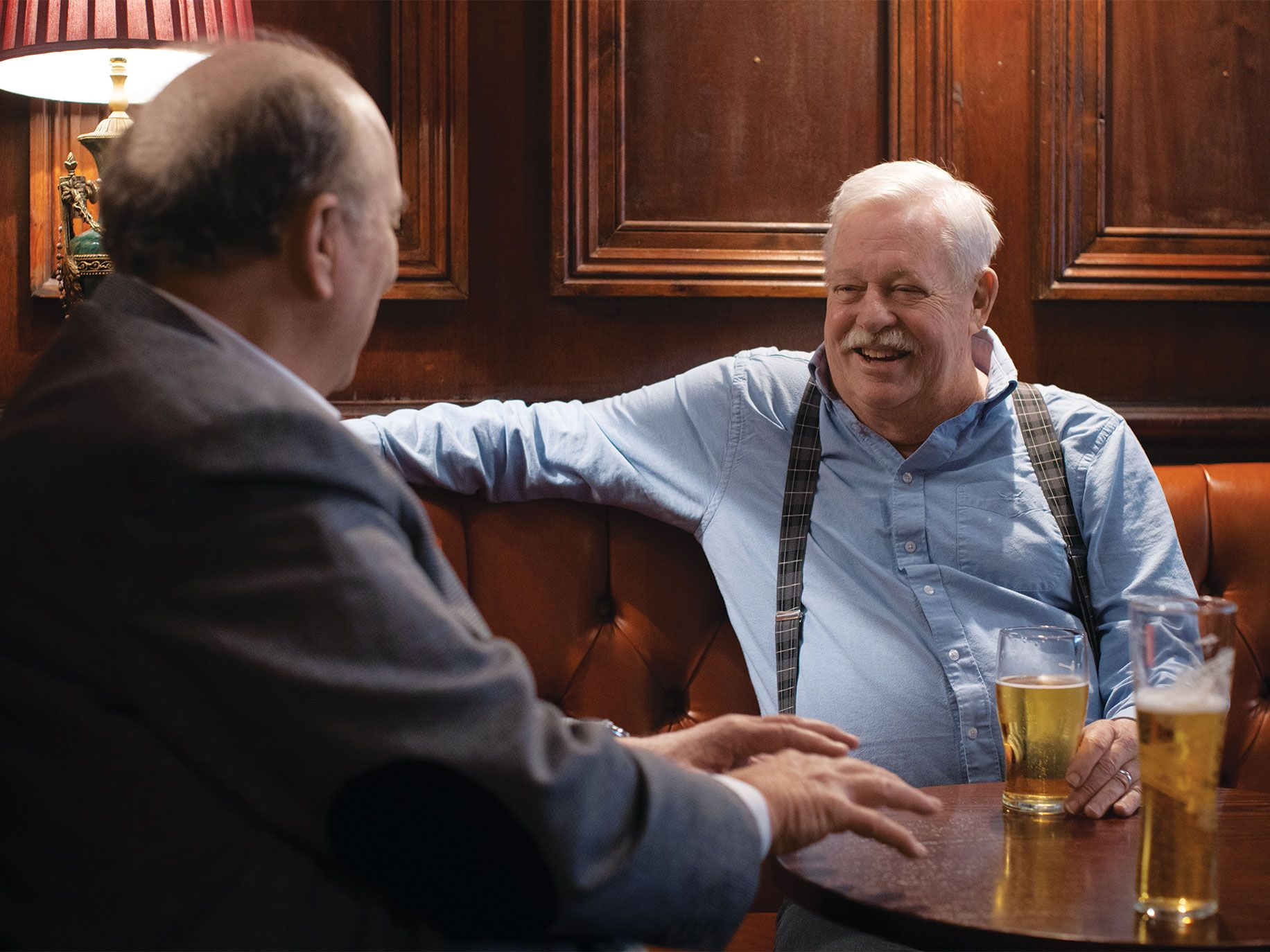 Alta editor and publisher Will Hearst (left) and writer Armistead Maupin enjoy pints of ale at Comptons of Soho, a London pub.
