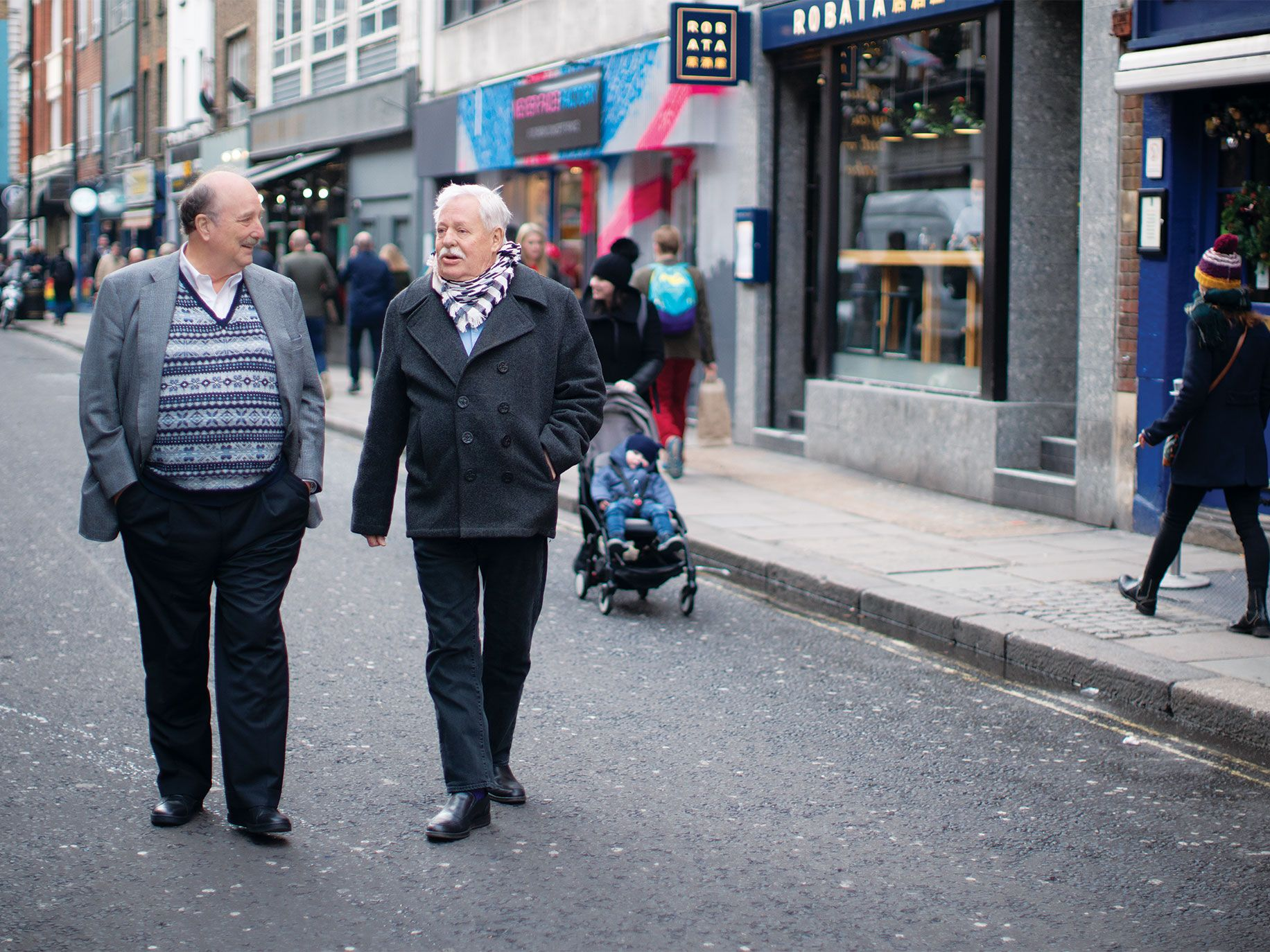 Hearst (left) and Maupin stroll along Old Compton Street in London.