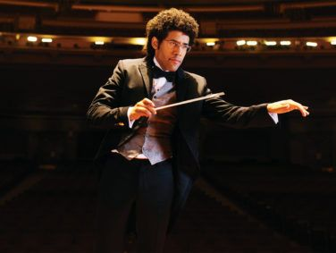 Rafael Payare, known for his energetic stage presence, conducts the San Diego Symphony.