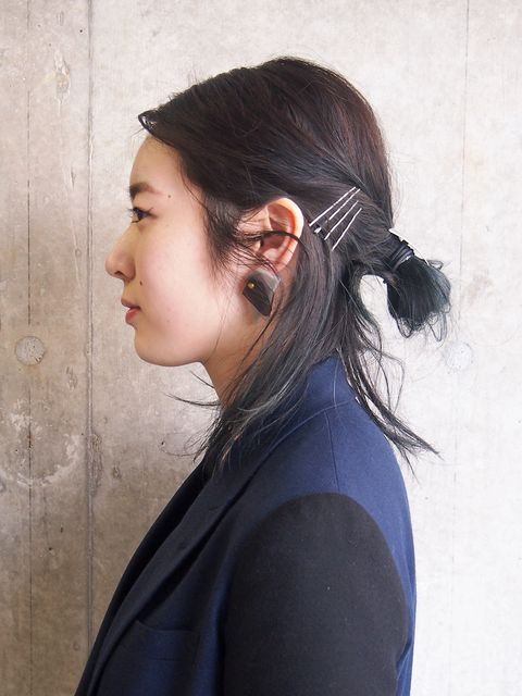 Ear, Hairstyle, Forehead, Earrings, Style, Black hair, Neck, Beauty, Eyelash, Long hair,