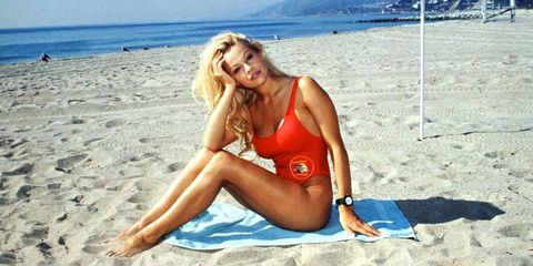 Clothing, Human leg, Coastal and oceanic landforms, Brassiere, Summer, Beach, Bikini, Sand, Undergarment, Sitting,