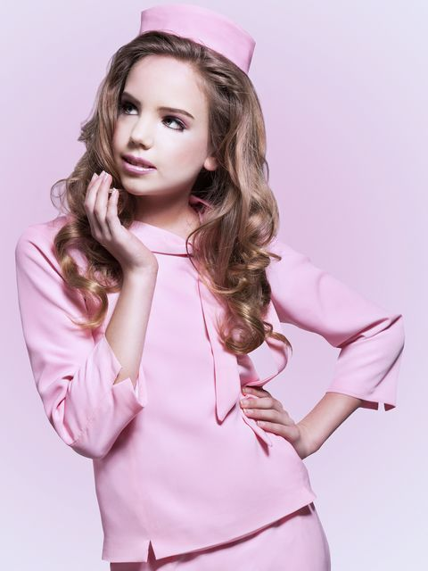 Lip, Hairstyle, Sleeve, Shoulder, Pink, Style, Costume accessory, Beauty, Eyelash, Magenta,
