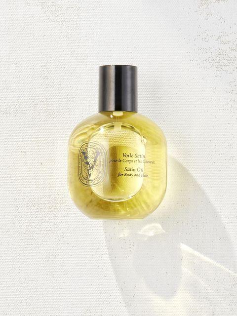 Product, Perfume, Bottle, Fluid, Glass bottle, Liquid, Bottle cap, Beige, Cosmetics, Distilled beverage,