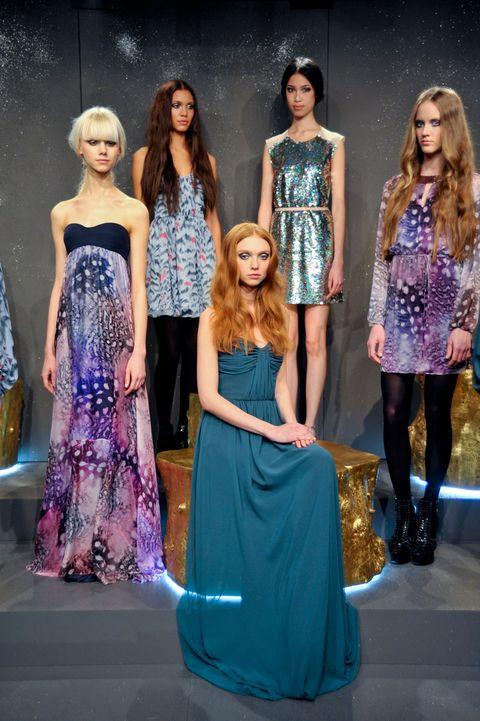 Clothing, Blue, Dress, Shoulder, Outerwear, Style, Formal wear, Fashion show, Waist, Fashion model,