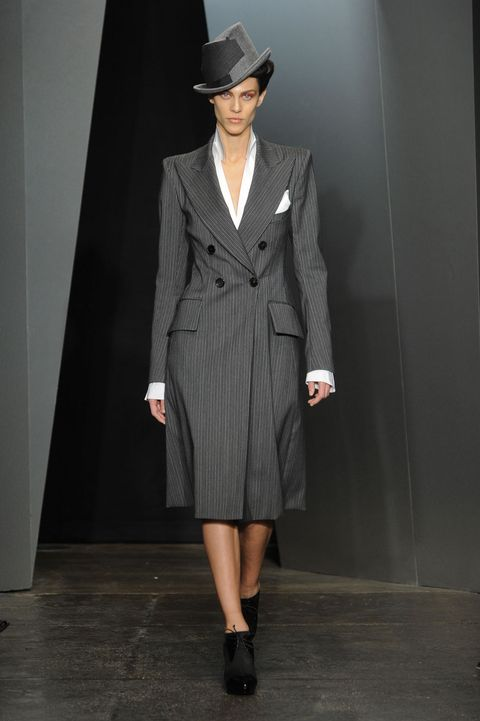 Clothing, Hat, Sleeve, Outerwear, Coat, Style, Fashion show, Formal wear, Fashion model, Collar,