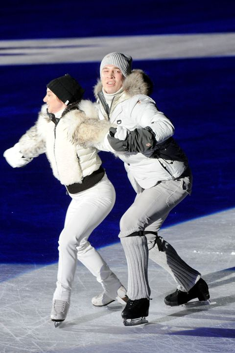 Winter, Ice skate, Glove, Knee, Ice rink, Dance, Active pants, Beanie, Snow, Fur,