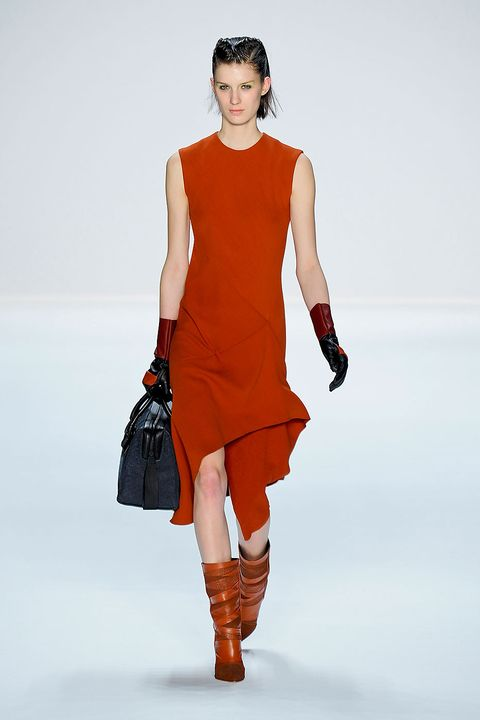 Clothing, Brown, Shoulder, Human leg, Dress, Textile, Joint, Fashion accessory, Style, Fashion model,