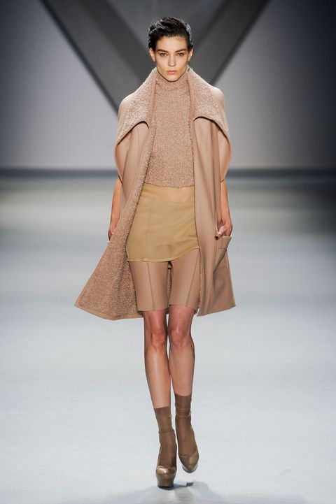 Clothing, Brown, Fashion show, Shoulder, Human leg, Joint, Outerwear, Runway, Style, Fashion model,